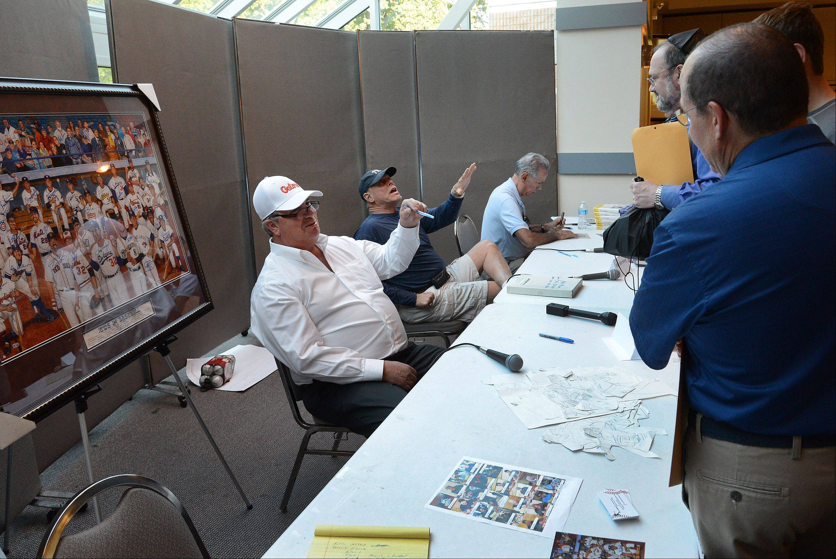 "From left, former White Sox players Ross Baumgarten and Ron Blomberg, along with former New York Met Art Shamsky, talk with fans Wednesday at ""A Night of Jewish Baseball"" at Congregation Beth Judea in Long Grove."