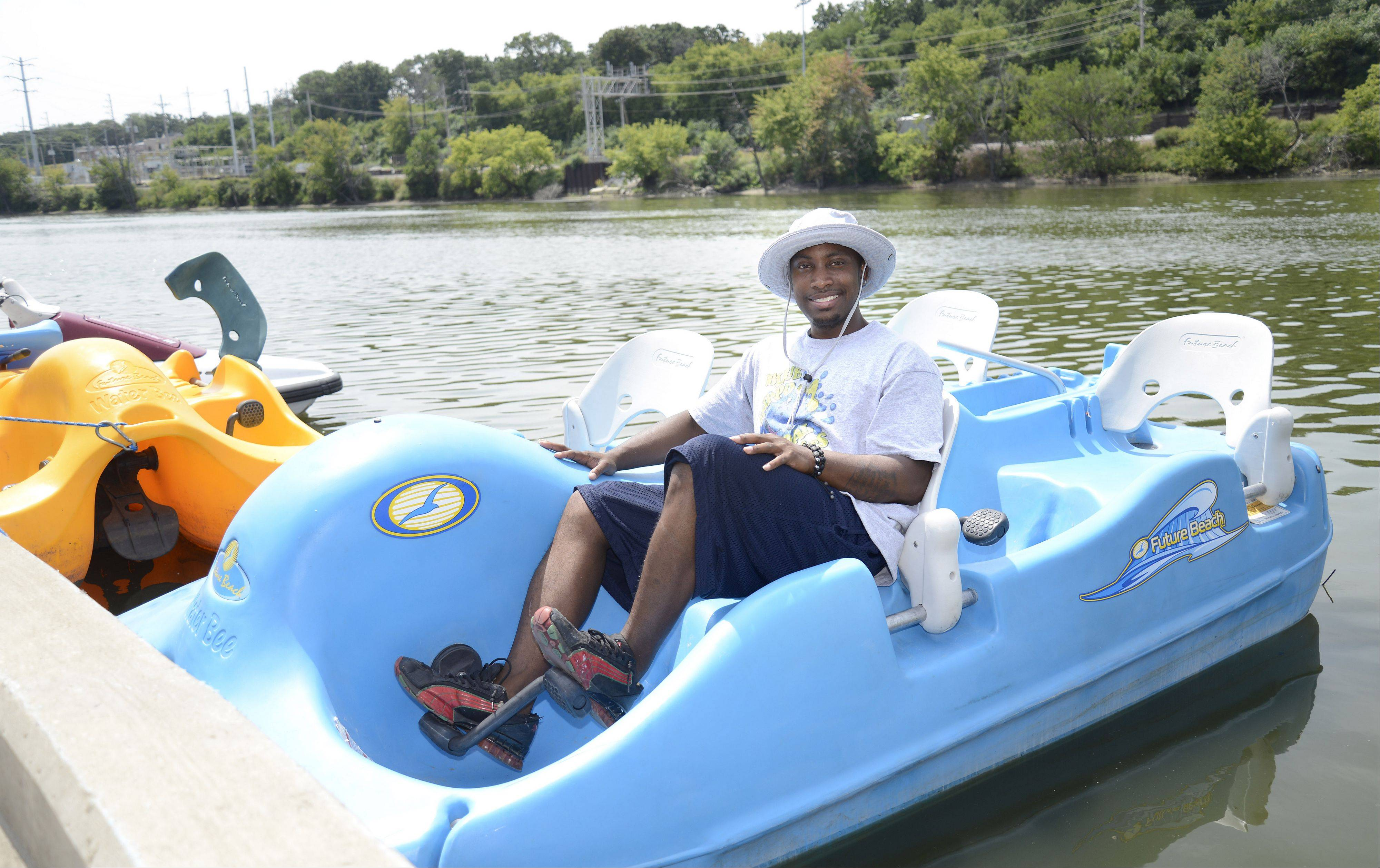 Justin Hodge, owner of Blue Hippo Pedal Boats at Festival Park in Elgin, said he never spent time on the Fox River before starting his business in late July.