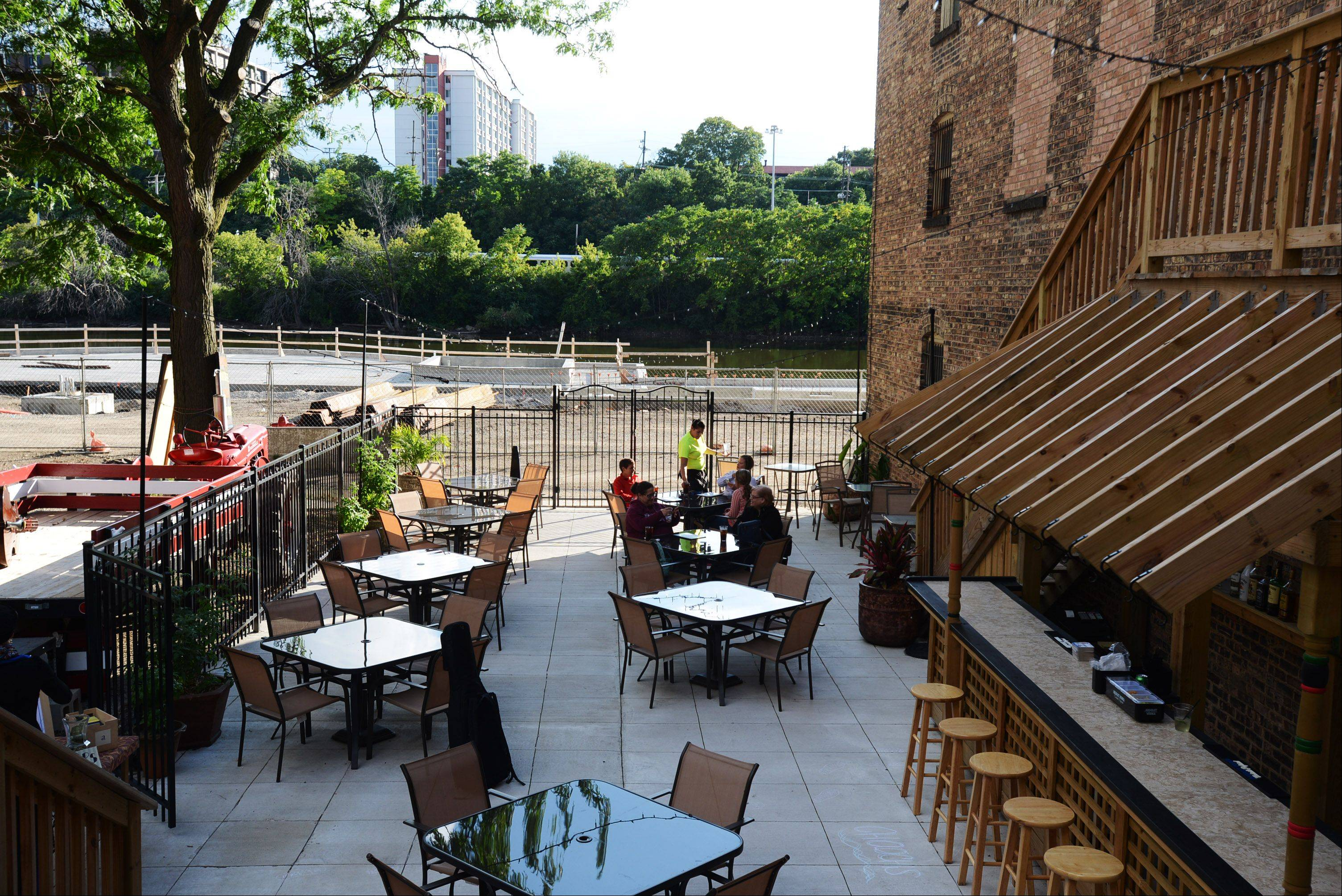 Chooch's Pizzeria on Grove Avenue is the first business to create a patio that has a view of the river. The business opened in December and the patio opened in June.