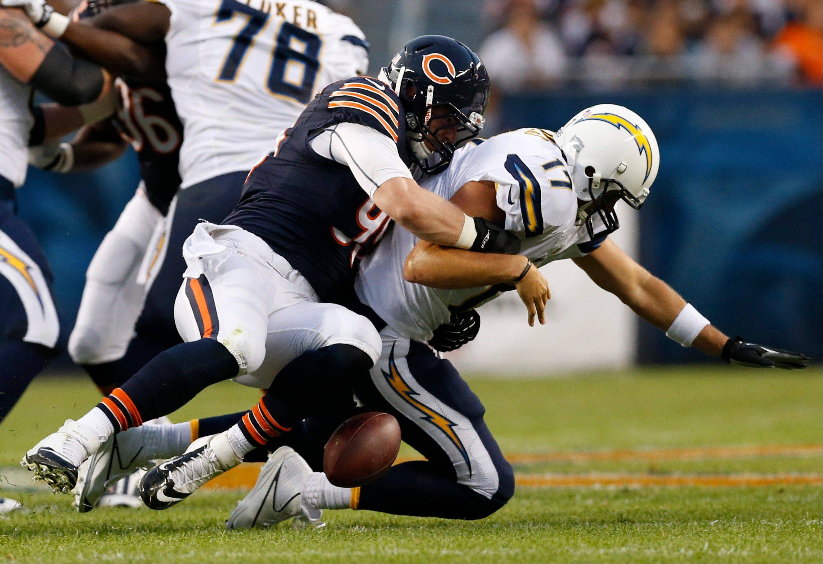 Chicago Bears defensive end Shea McClellin (99) sacks San Diego Chargers quarterback Philip Rivers (17) during the first half of the preseason NFL football game, Thursday, Aug. 15, 2013, in Chicago. Rivers loses the ball which was recovered by Bears safety Major Wright on the play.