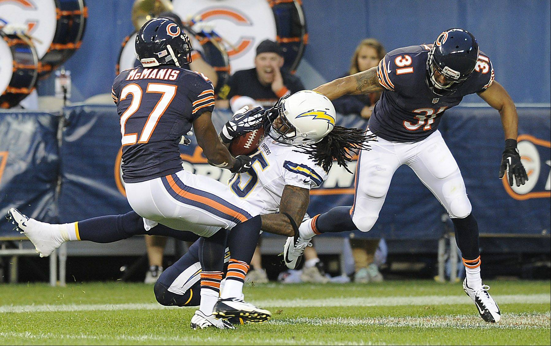 Chicago Bears Isaiah Frey tackles the Chargers' Richard Goodman with the help of teammate Sherrick McManis on a kick return.