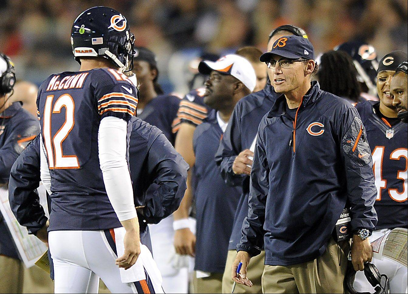 Chicago Bears head coach Marc Trestman talks with Bears quarterback Josh McCown.