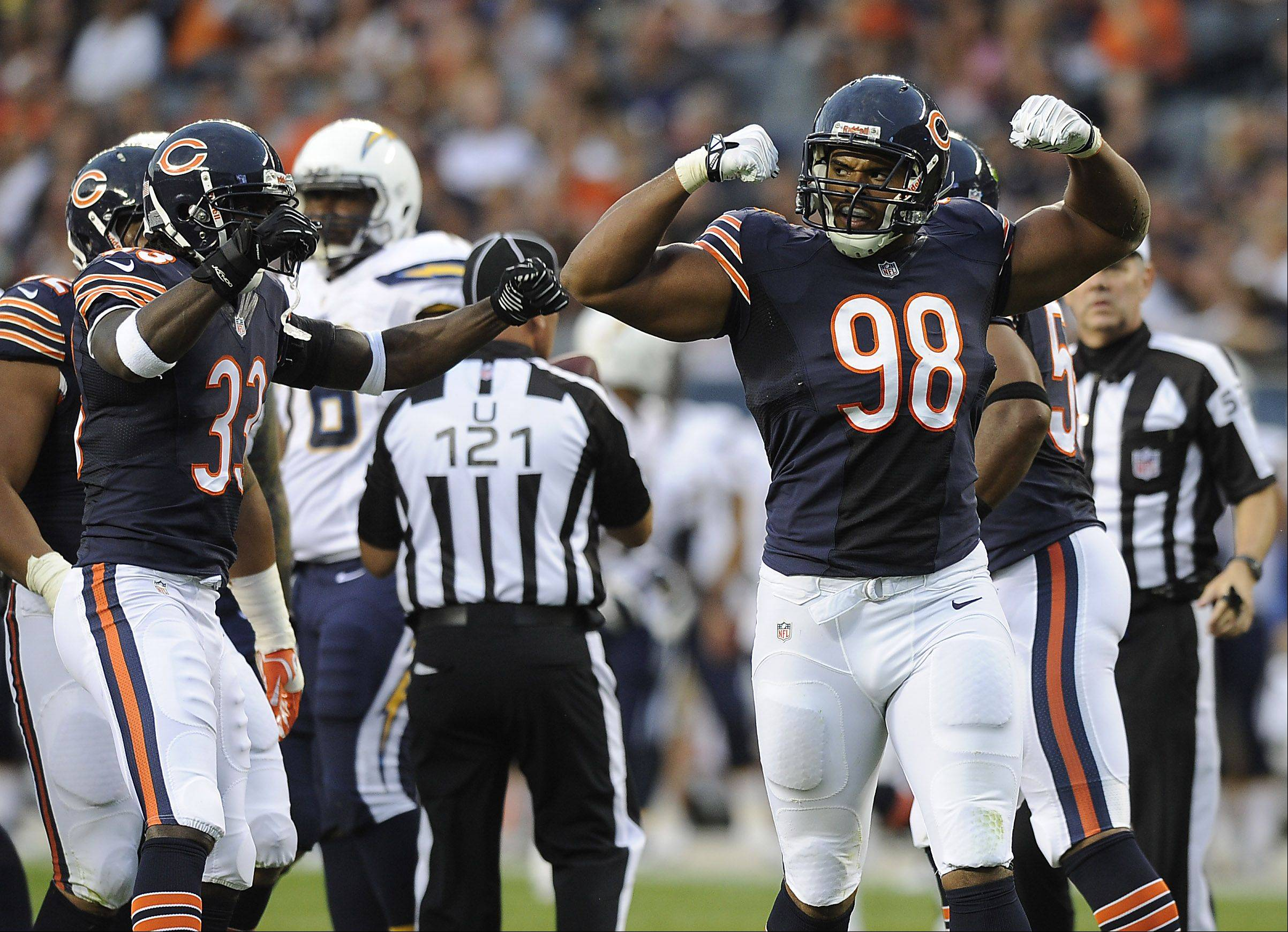Chicago Bear Corey Wootton reacts after sacking Chargers' quarterback Phillip Rivers in the first half.