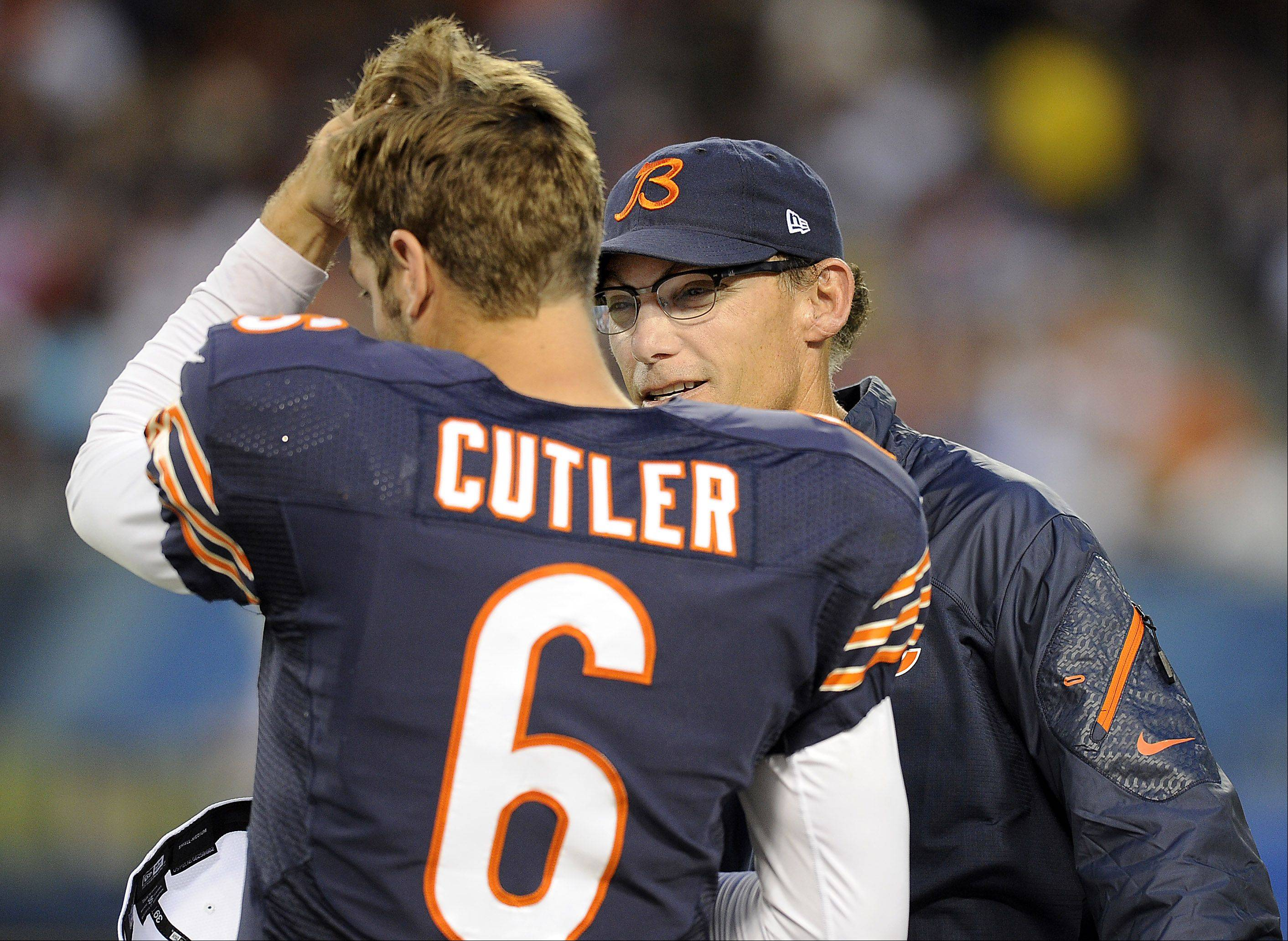 Chicago Bears head coach Marc Trestman talks with quarterback Jay Cutler on the sidelines.