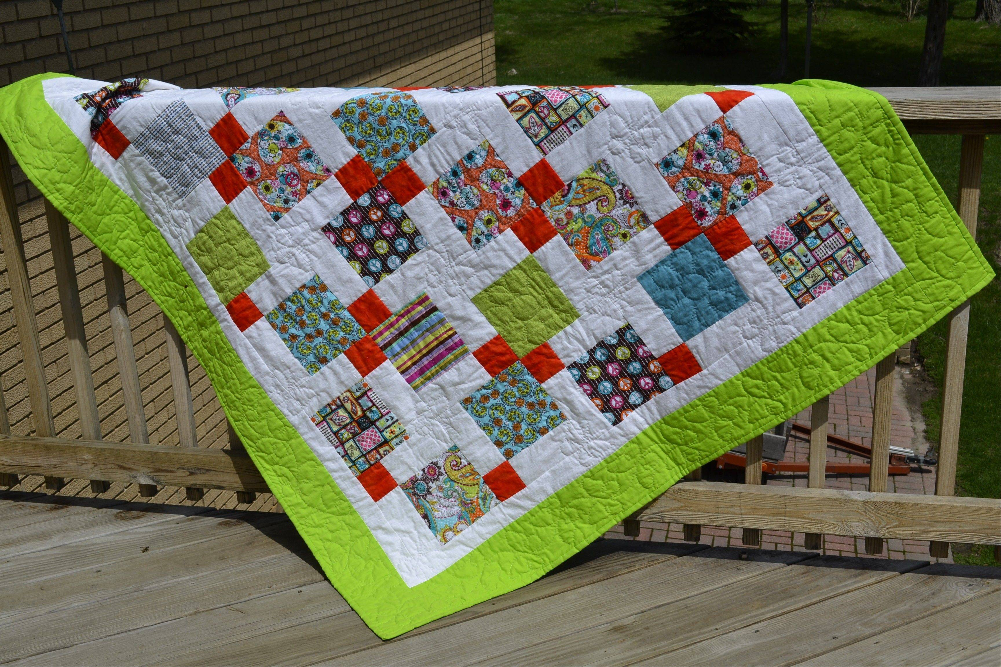 Palatine Park District's Quilting with Margaret group recently donated six handmade quilts to girls in counseling at Northwest Treatment Associates. Pictured is the Bright and Lovely Quilt.