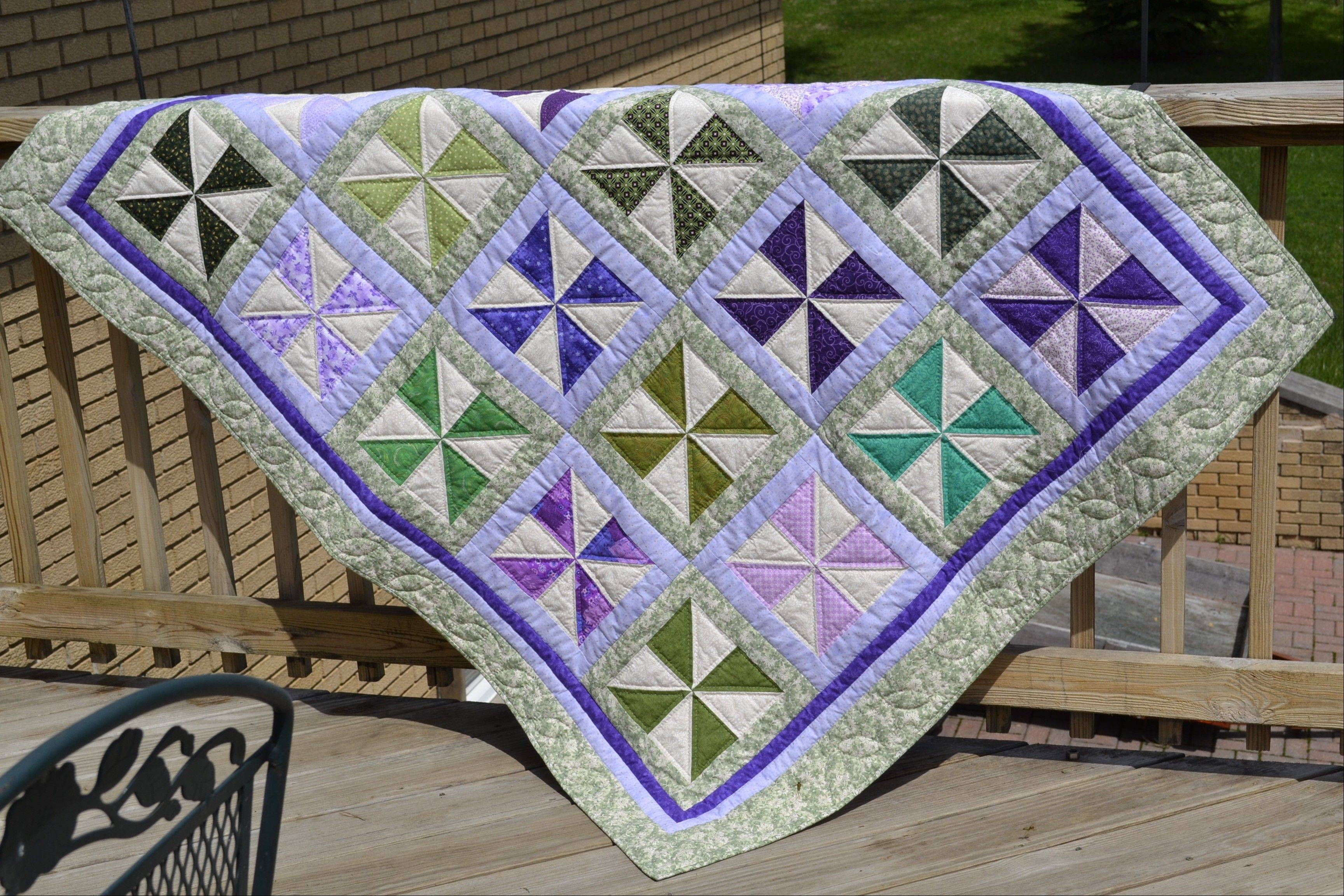 Pictured is the Friendly Pinwheels Quilt, one of the quilts donated by the Palatine Park District's Quilting with Margaret group to girls in counseling at Northwest Treatment Associates.