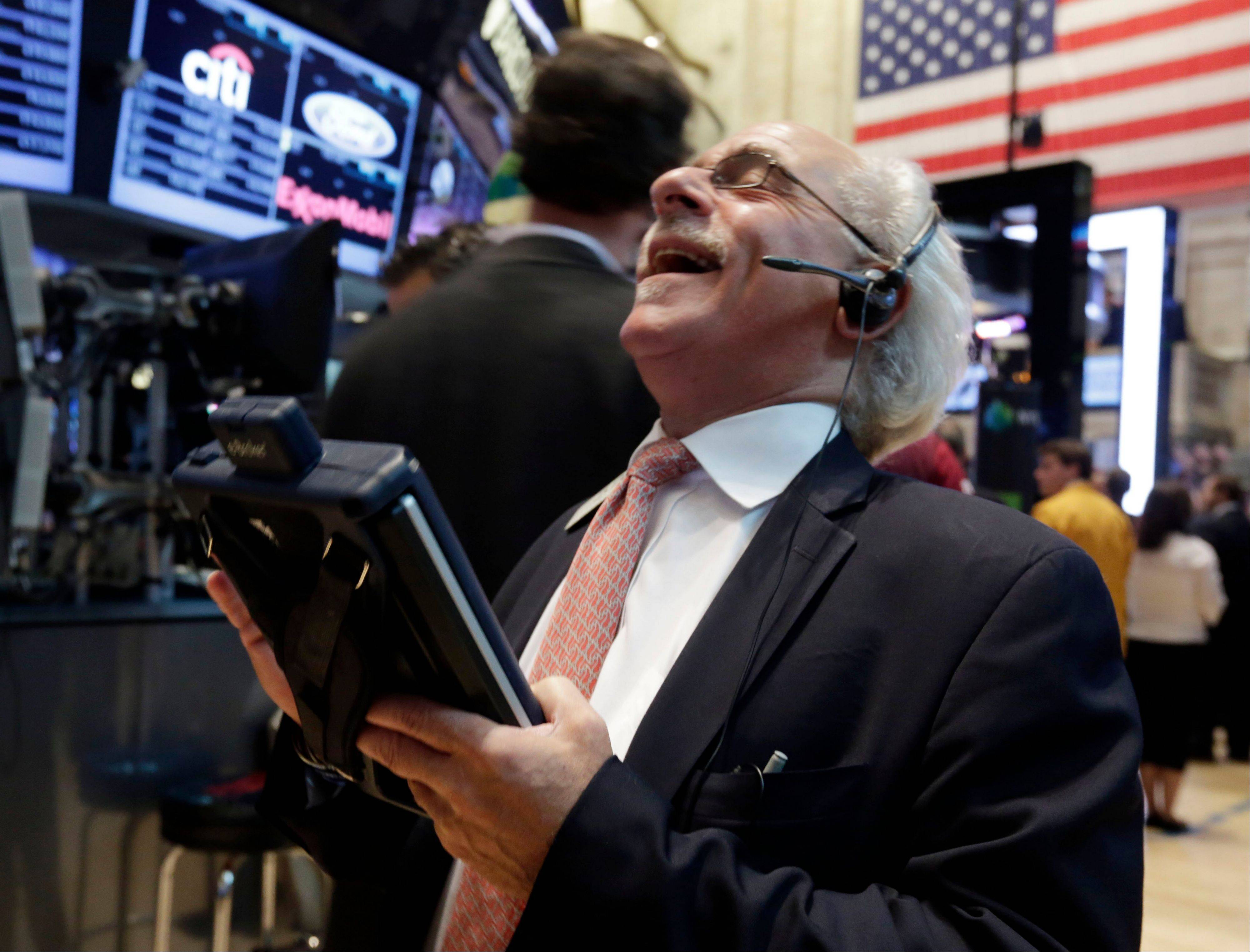 Trader Peter Tuchman reacts to another trader�s comment as he works Friday on the floor of the New York Stock Exchange.