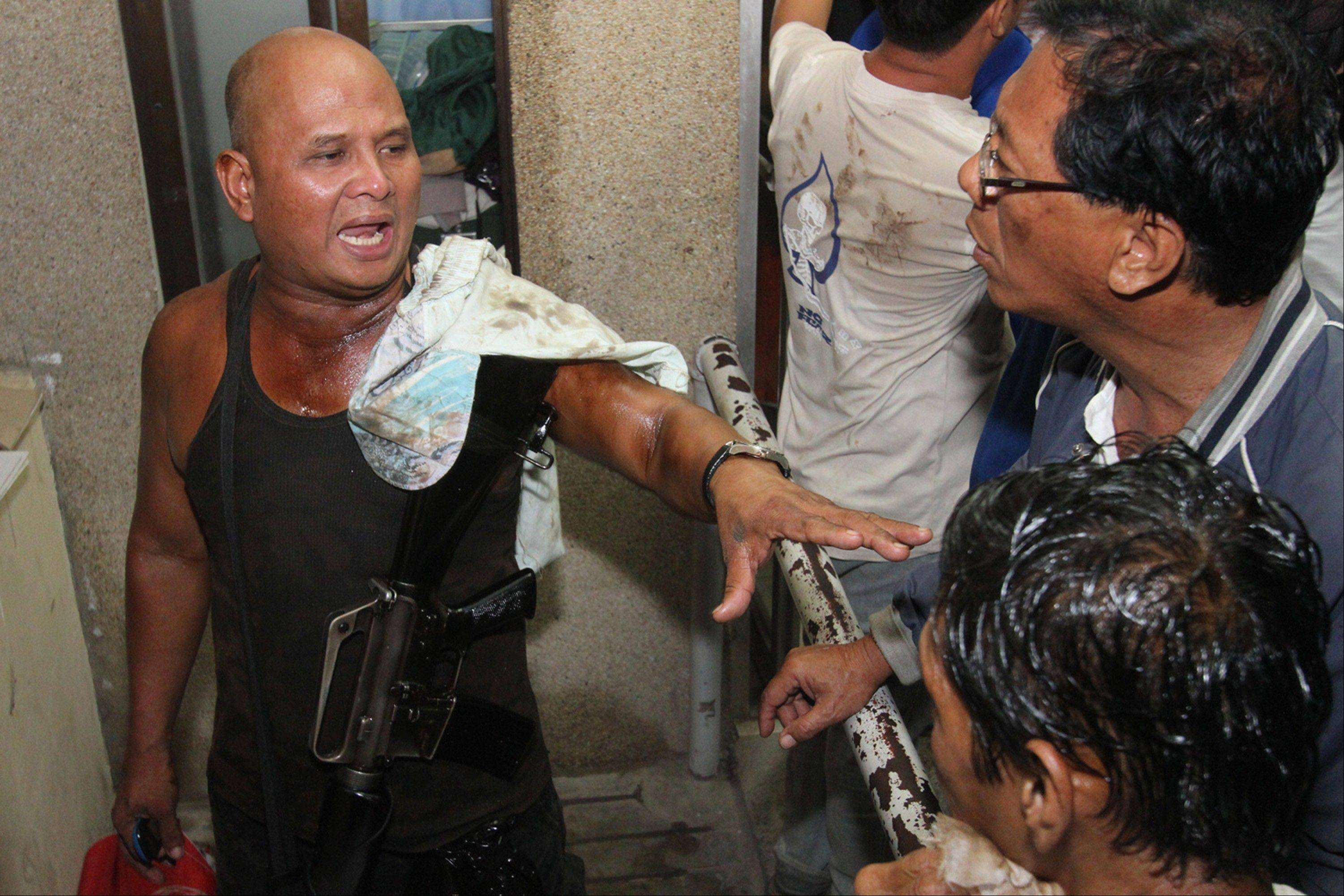 A Filipino trooper explains Friday how he survived as his ship sank in Cebu, central Philippines.