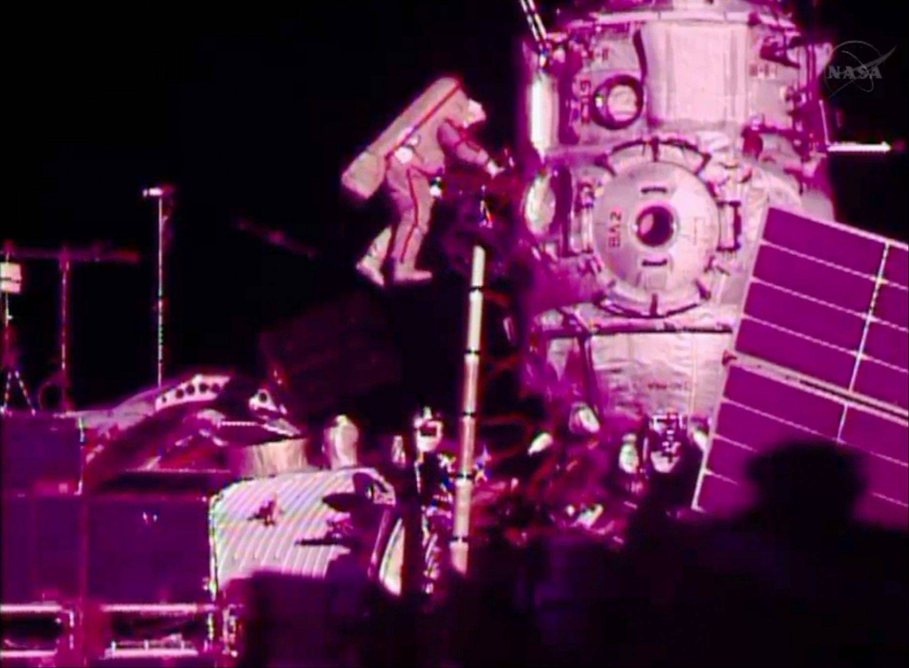 In this image from video made available by NASA, Russian cosmonaut Fyodor Yurchikhin participates in a spacewalk outside the International Space Station on Friday, Aug. 16, 2013. Yurchikhin and Aleksandr Misurkin are to install cabling for a new lab due to arrive at the station in a few months.