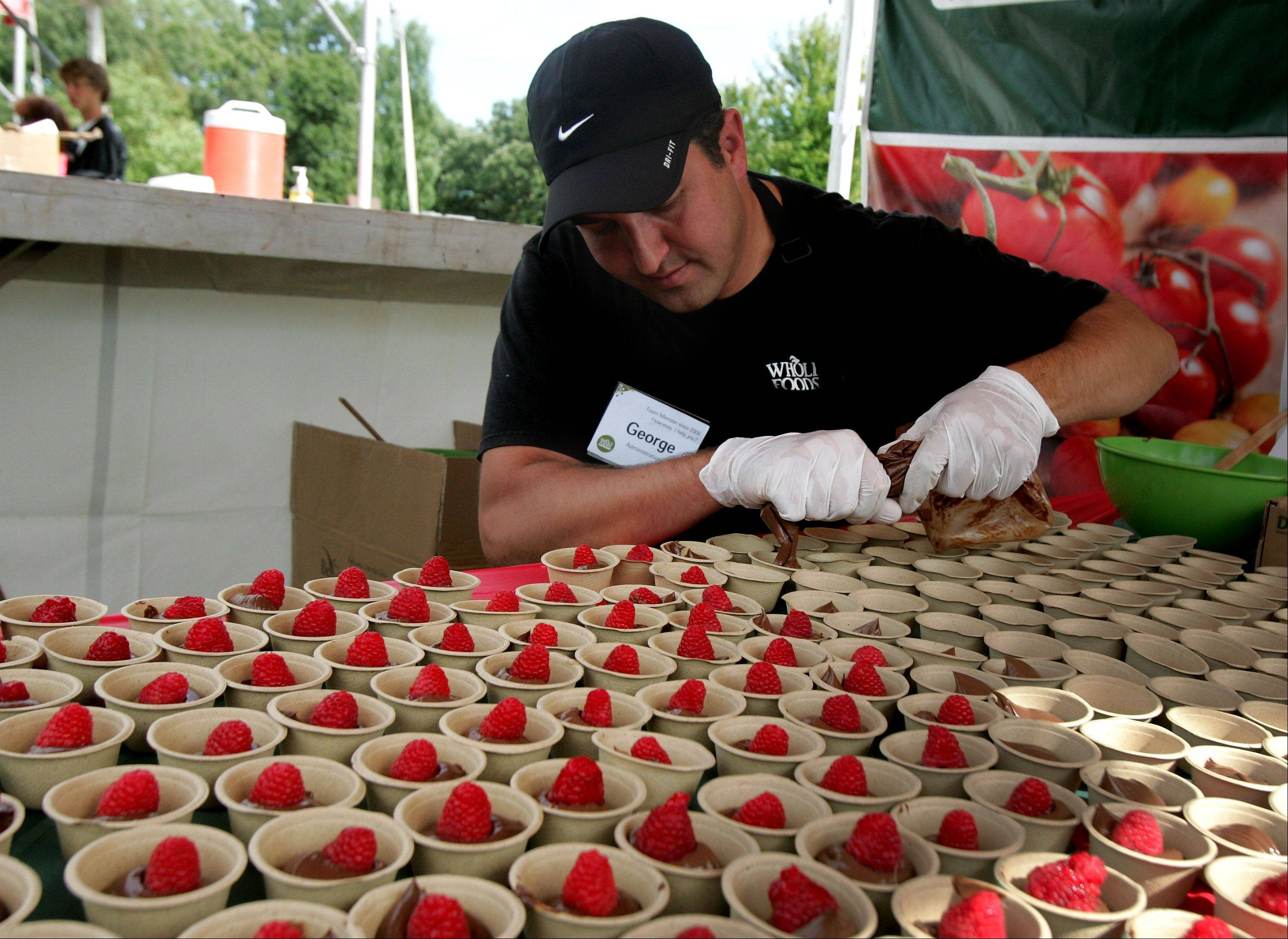 George Economos of Whole Food Markets makes vegan chocolate mousse with organic raspberries during a Taste of the Towns event at Paulus Park in Lake Zurich.