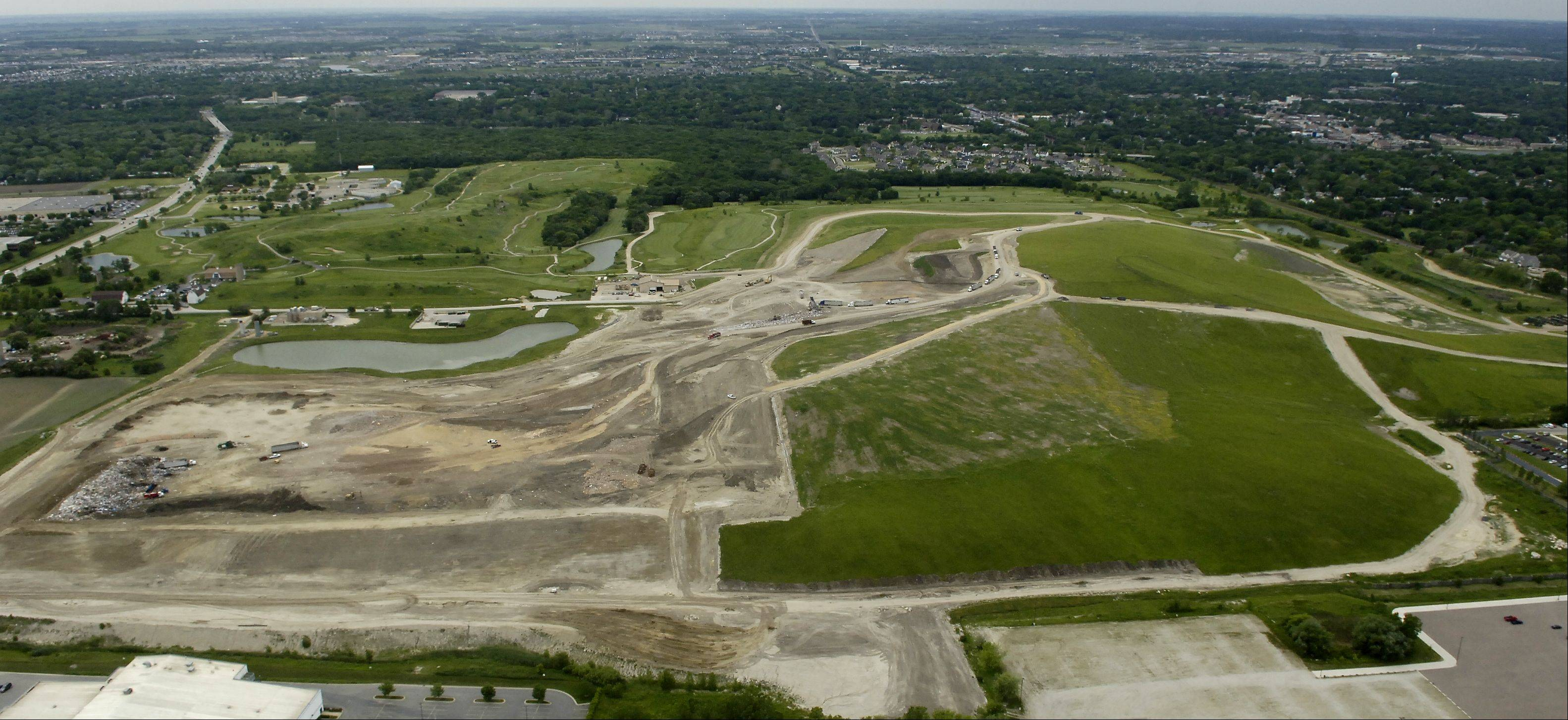Kane County officials are starting to put money behind significant recreational changes to the former Settlers Hill landfill in Geneva.