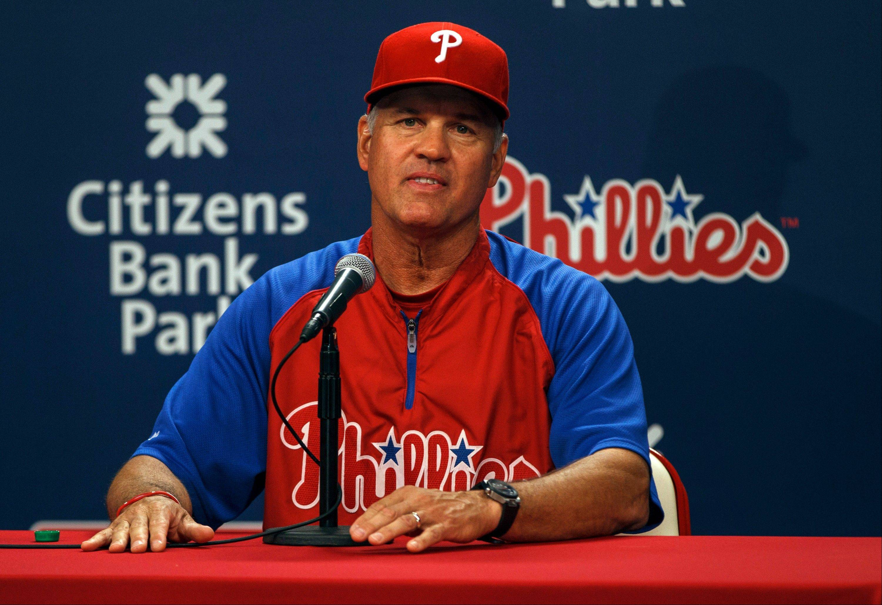 Ryne Sandberg takes questions from reporters after being announced as Philadelphia�s manager during a news conference before the Phillies played the Dodgers on Friday.