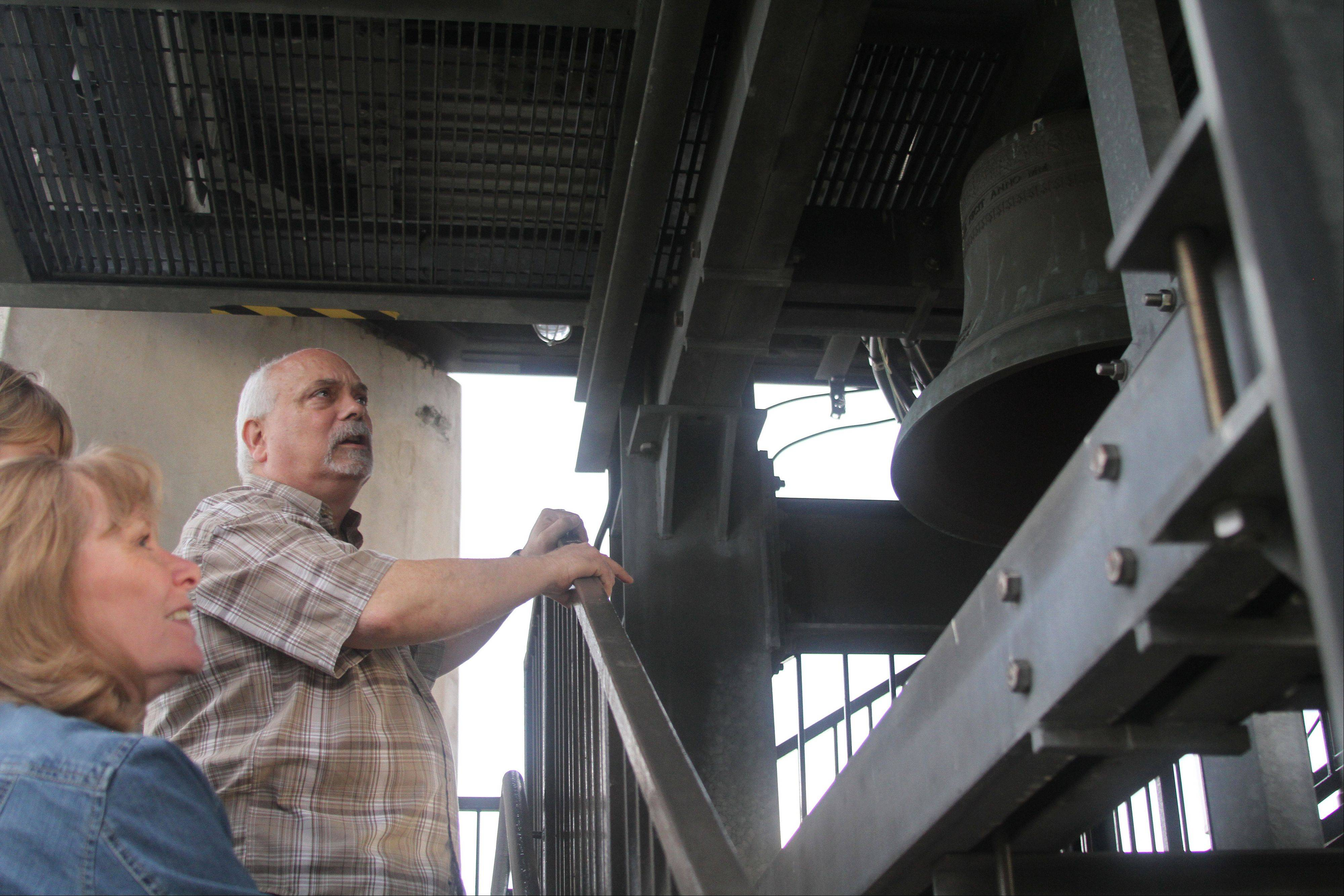 Tim Sleep, Naperville city carillonneur, leads a tour of the Millennium Carillon in Moser Tower before a summer Saturday recital. Public education about the 72-bell instrument is an important part of Sleep's job as lead performer on Naperville's carillon.