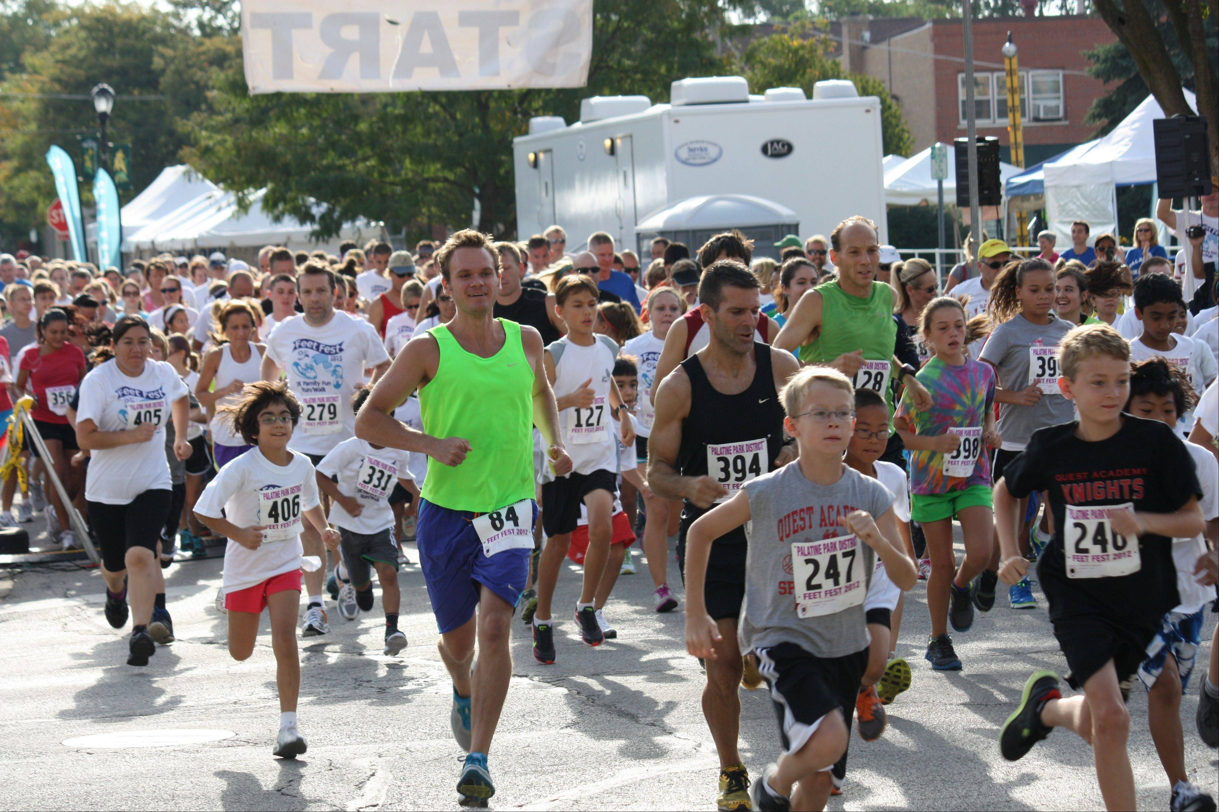 COURTESY OF THE PALATINE PARK DISTRICTRunners take off at the starting point of the 2012 Feet Fest.