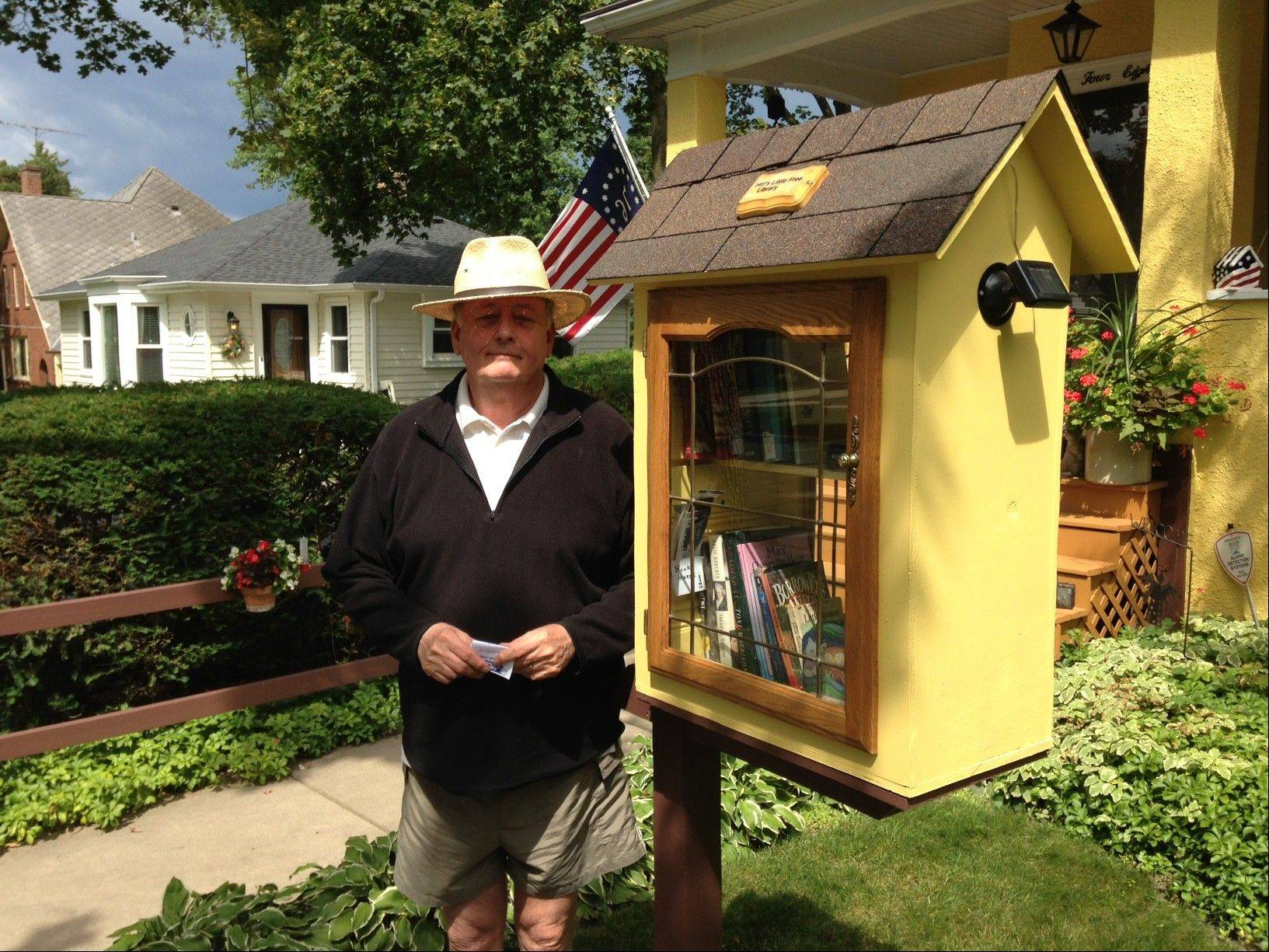 Mike Hill loves the Little Free Library his son built for him. People can take or leave books at any time. Solar-powered lighting illuminates the shelves at night.
