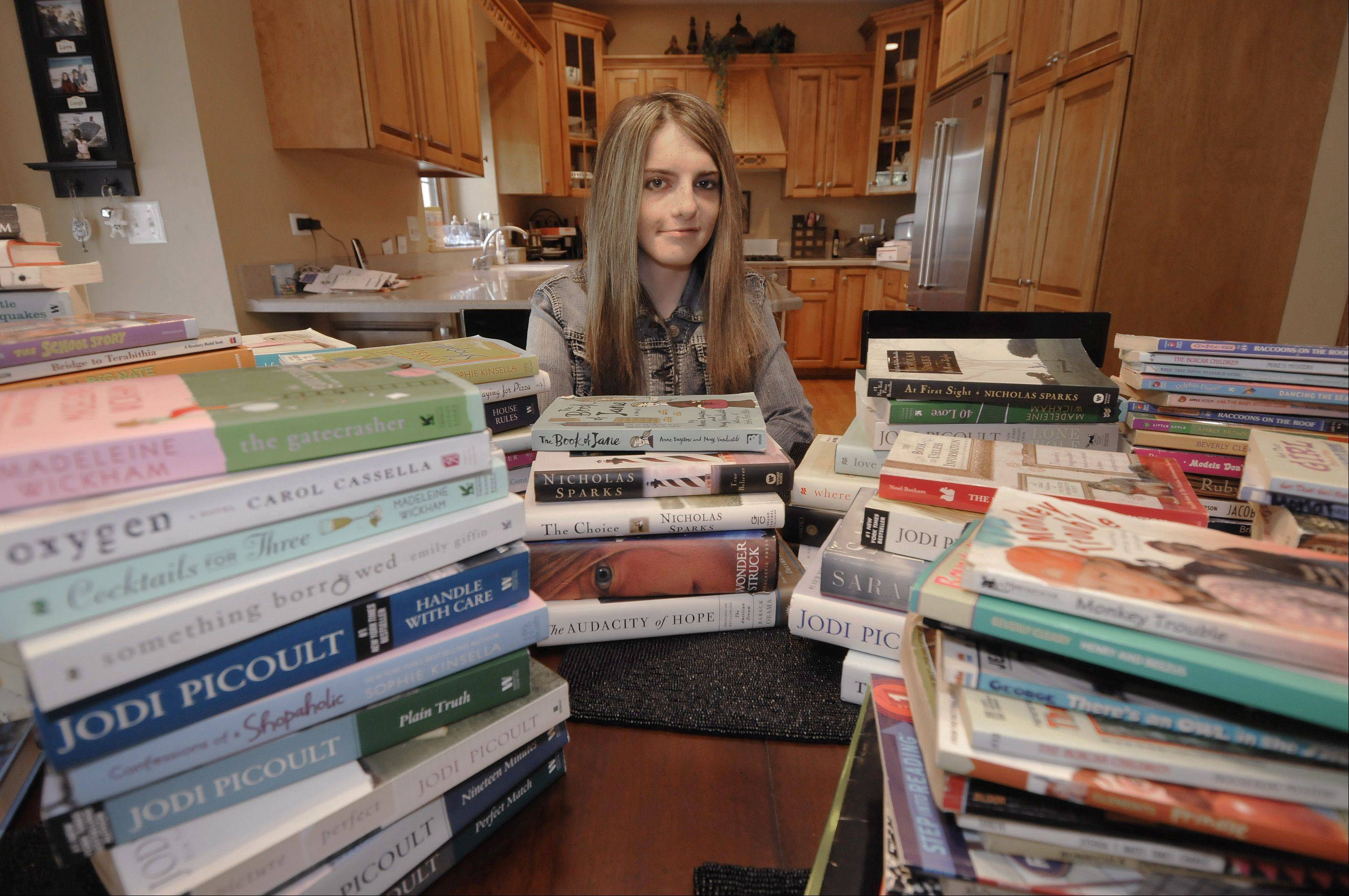 Kayla Dunlea of Wayne will start her junior year Monday at St. Francis High School in Wheaton. She decided to help women and their children relax while they're staying at the DuPage Family Shelter in Wheaton by donating about 175 books for them to read while there.
