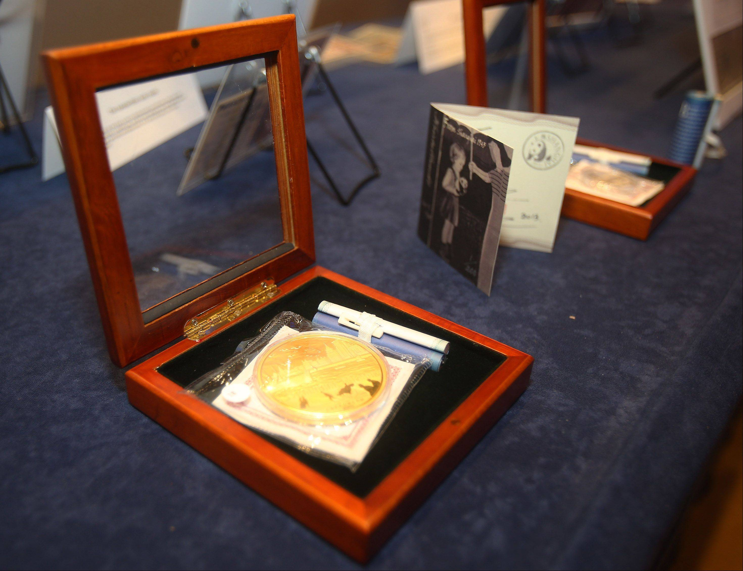 "Coins commemorating the Shanghai Ghetto are on display during the presentation ""Shanghai Memory"" based on survivors of the World War II Shanghai Ghetto Thursday at the Hyatt Regency in Rosemont. The Shanghai Ghetto in China was an area where Jews fled Europe to escape Nazi persecution."