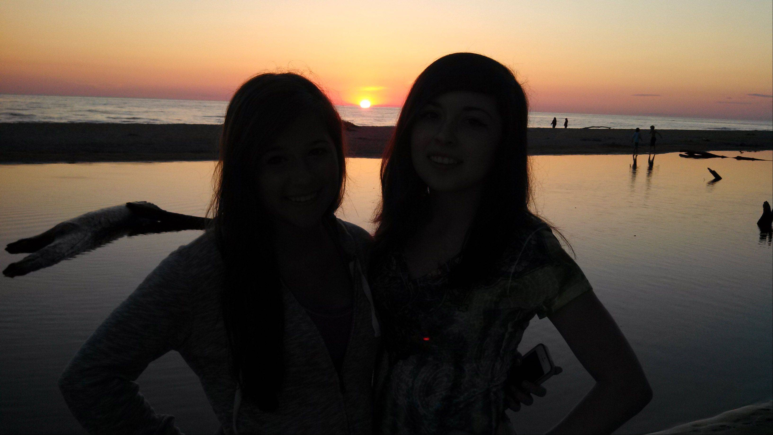 This silhouetted sunset photo of my two daughters was snapped during our recent camping trip to PJ Hoffmaster State Park in Michigan.