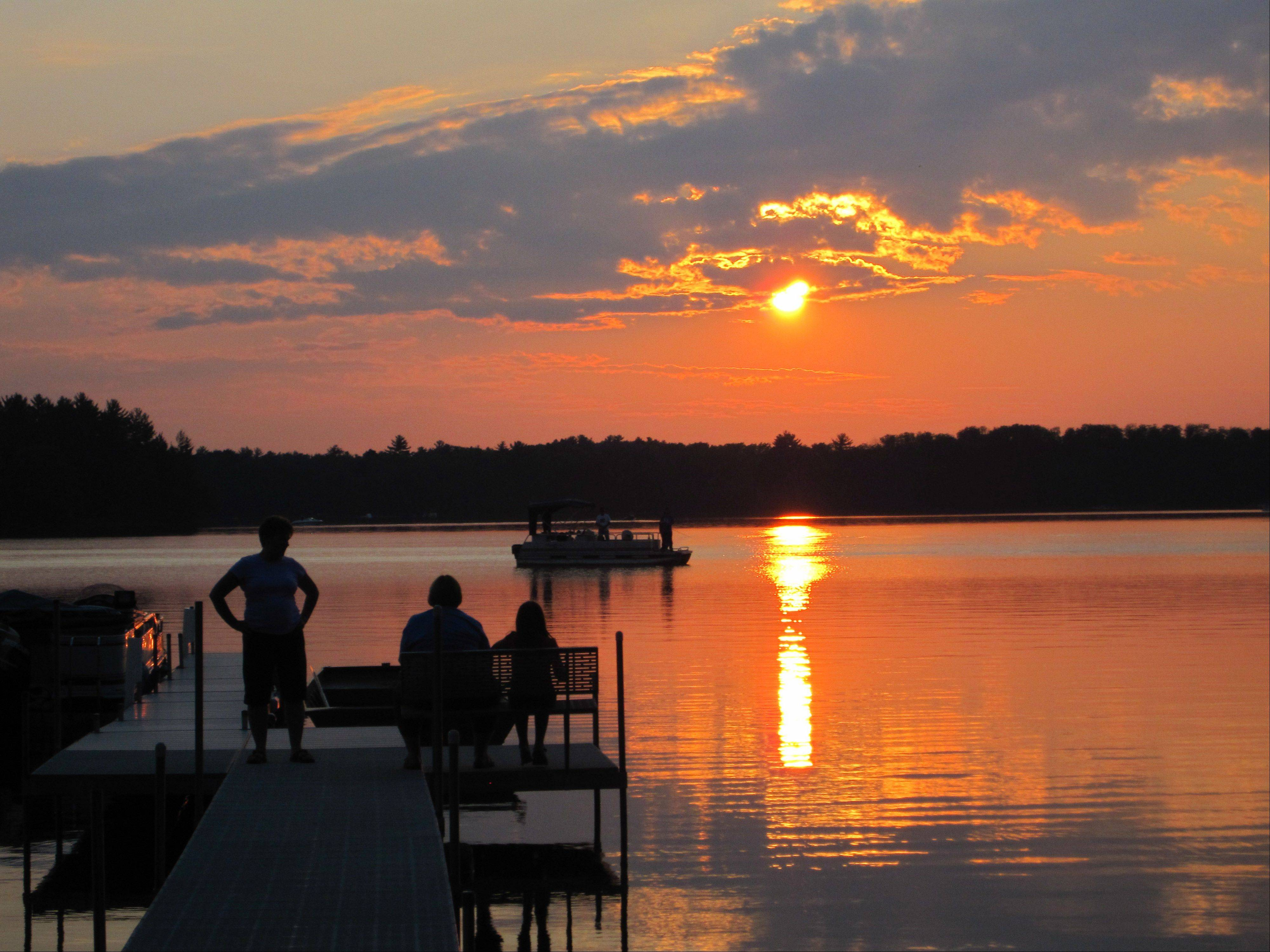 This photo of grandma, mother and granddaughter Thea on the dock watching the sunset was taken in the evening at Meta Lake, Eagle River, WI at the Timberlane Resort.
