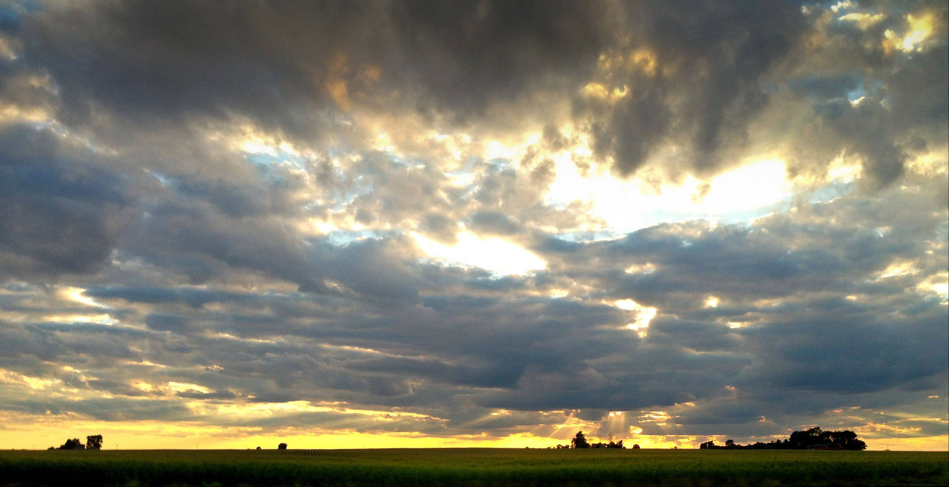 The sun sets over a farm in central Illinois near Champaign last July.
