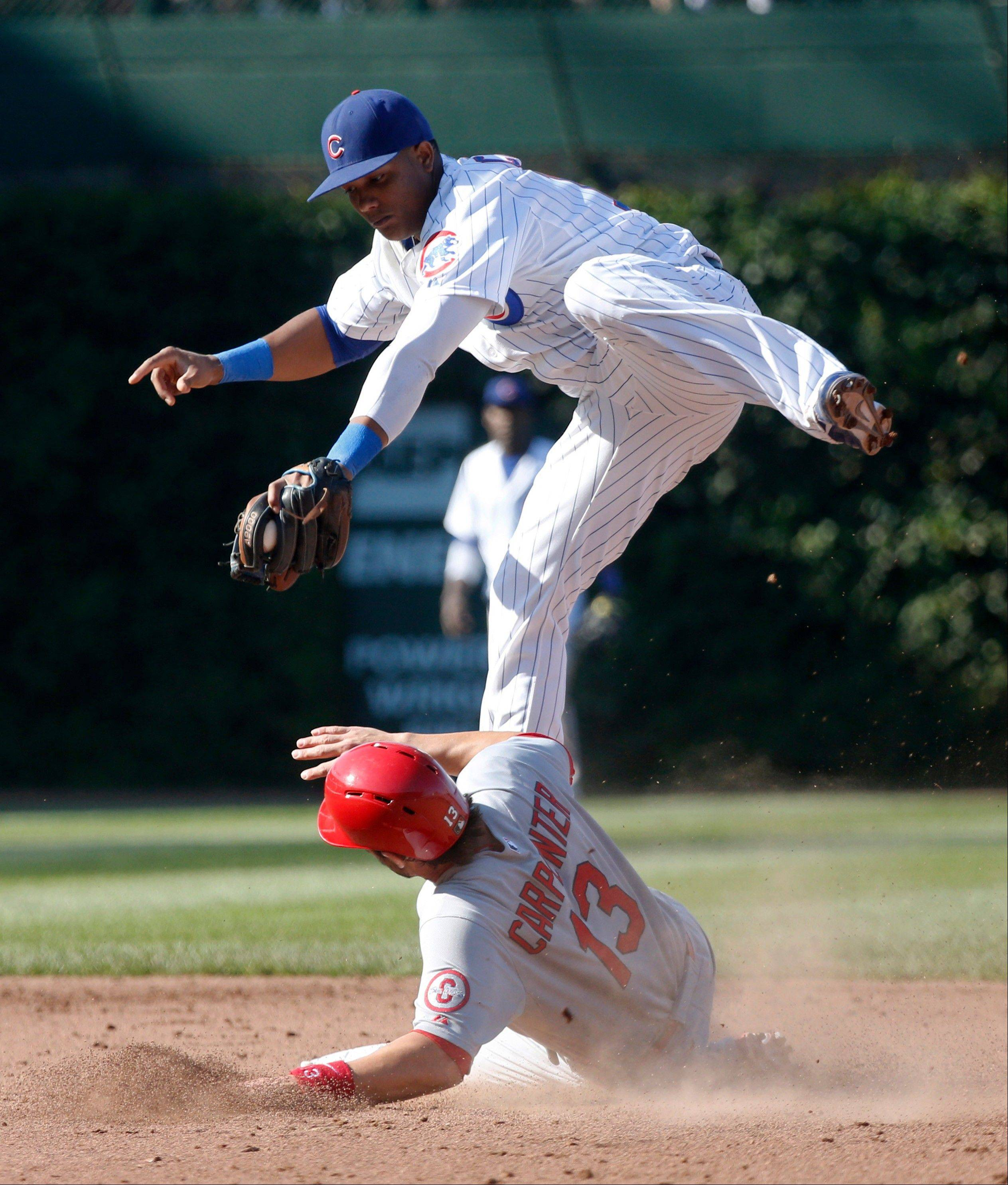 Cubs' shortstop Starlin Castro takes a high throw from second baseman Darwin Barney off a ball hit by St. Louis Cardinals' Jon Jay and forces out Matt Carpenter at second during Friday's game at Wrigley Field. The Cubs won 7-0.