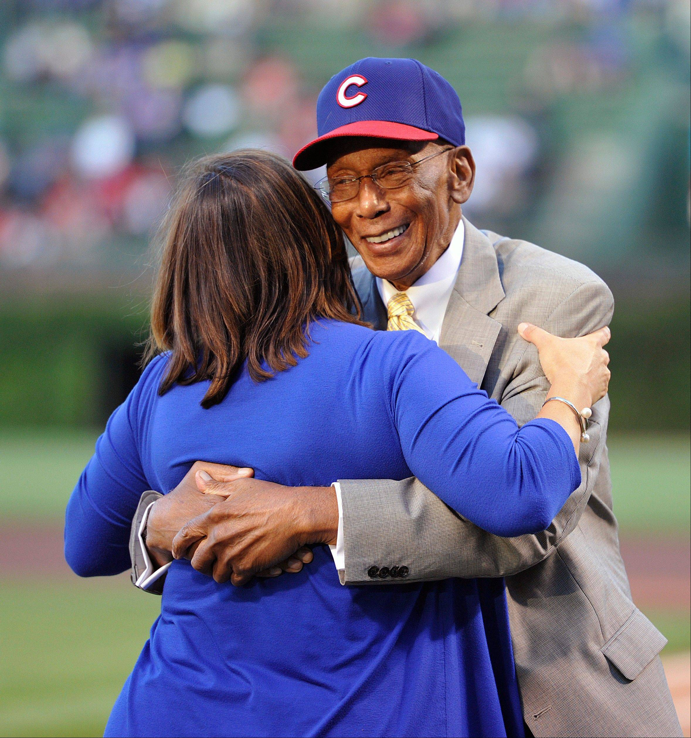 Former Chicago Cubs first baseman Ernie Banks dances with Laura Ricketts, co-owner of the Cubs, during a ceremony at Wrigley Field honoring Banks, who will receive the Presidential Medal of Freedom later this year.
