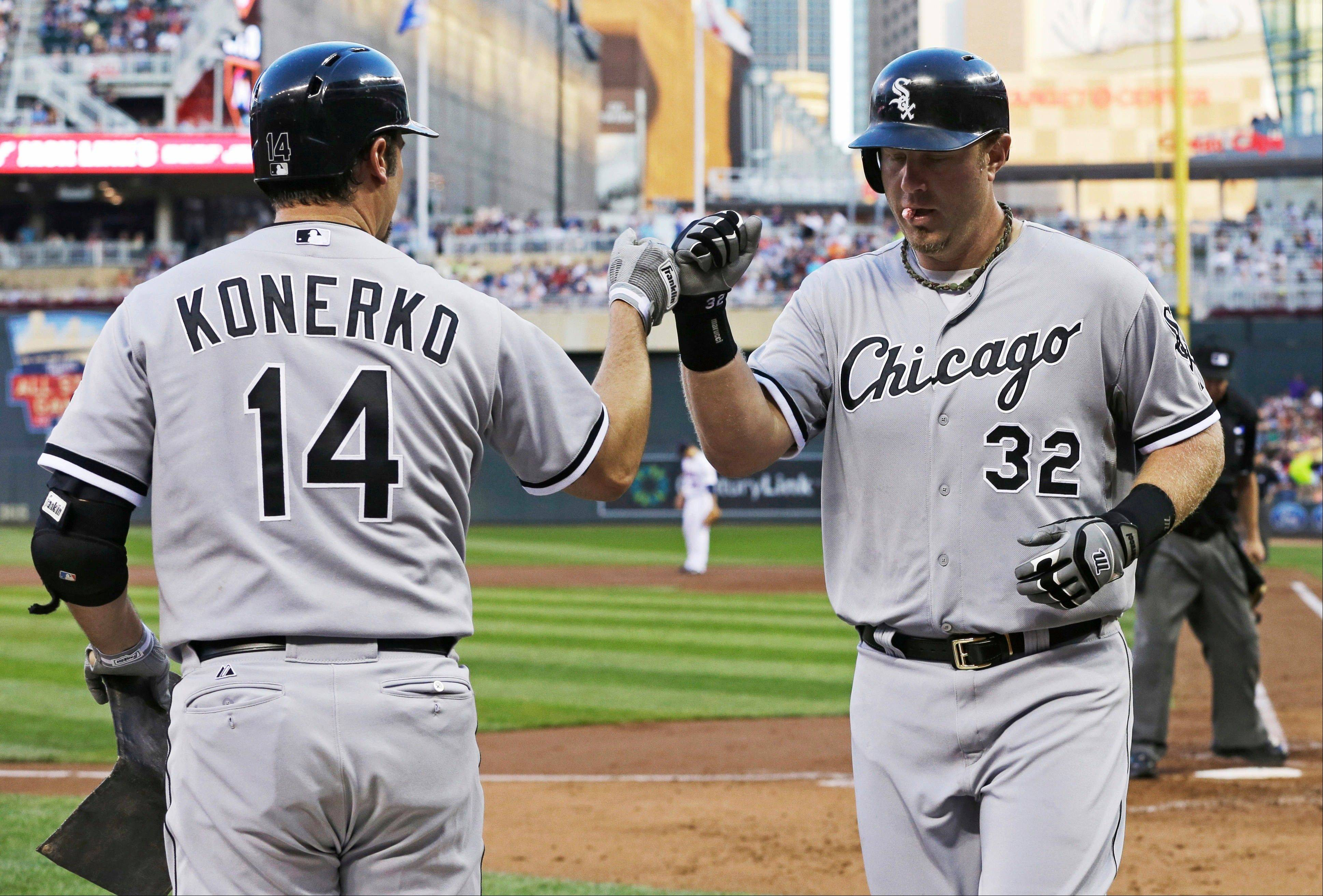 Paul Konerko, left, congratulates Adam Dunn after Dunn's solo home run off Minnesota Twins pitcher Kevin Correia during Friday night's game in Minneapolis. The Sox beat the Twins 5-2.