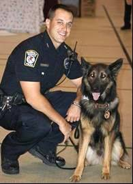 A memorial service is set for Sunday for Glendale Heights canine officer Don Darby, shown with his dog, Lucky. Darby died after a yearlong battle with brain cancer.