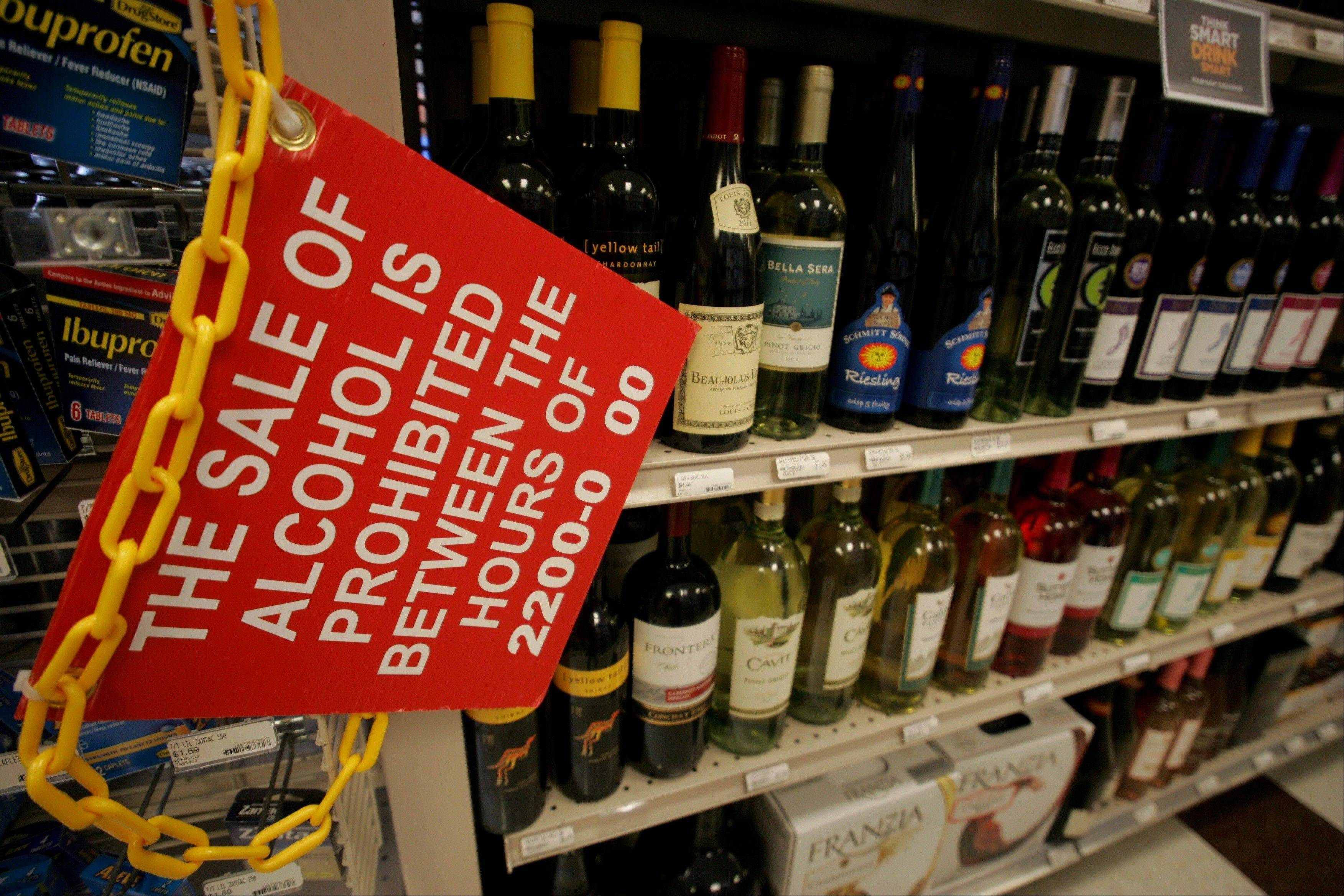 A sign prohibiting the sale of alcohol between certain hours hangs in the aisle at the Naval Station Norfolk Main Exchange,