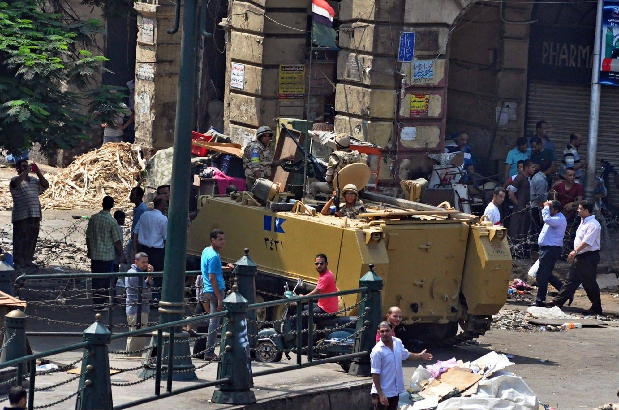 Associated Press Egyptians Army forces stand guard outside the al-Fatah mosque after hundreds of Islamist protesters barricaded themselves inside the mosque overnight, following a day of fierce street battles that left scores of people dead, near Ramses Square in downtown Cairo Saturday, Aug. 17. Authorities say police in Cairo are negotiating with people barricaded in a mosque and promising them safe passage if they leave. Muslim Brotherhood supporters of Egypt's ousted Islamist president are vowing to defy a state of emergency with new protests today, adding to the tension.