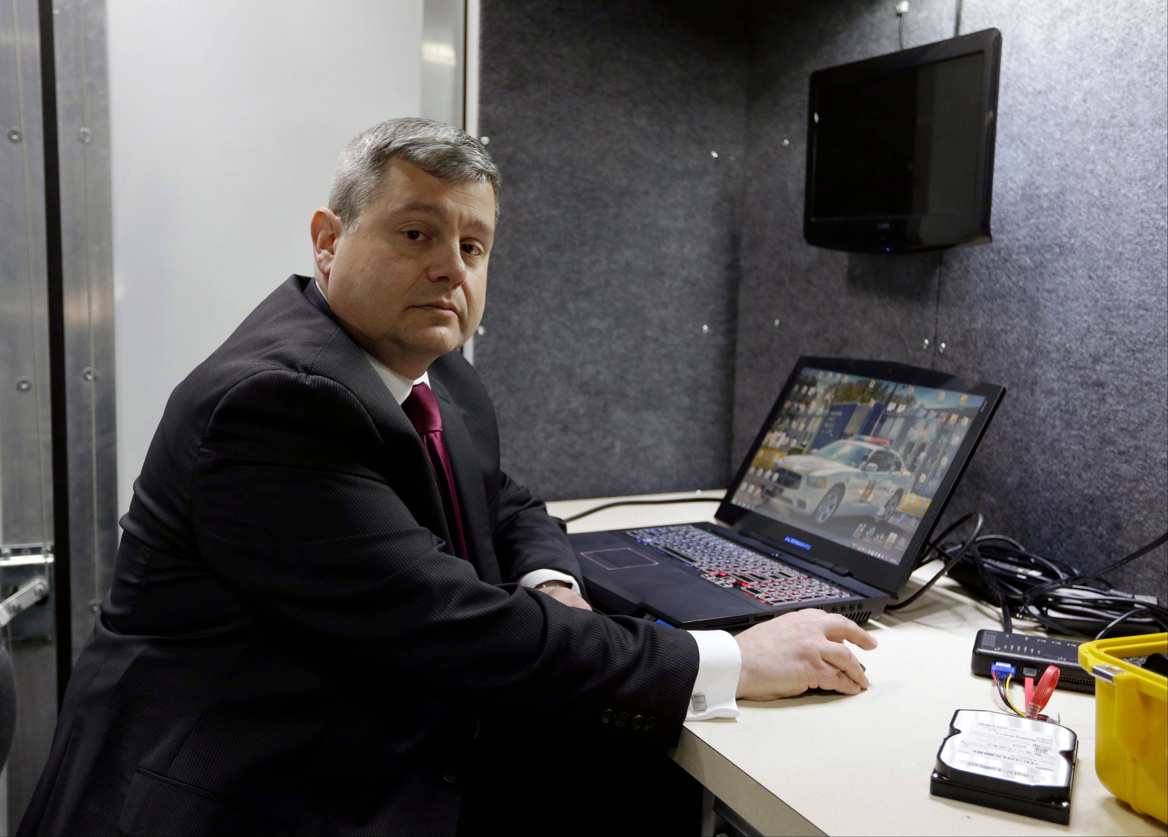 In this Feb. 19 photo, Indiana State Police Lt. Chuck Cohen poses for a photo in a mobile crime lab in Indianapolis. The lab is used by an Indiana task force that is building a national reputation for aggressive pursuit of child pornographers worldwide.