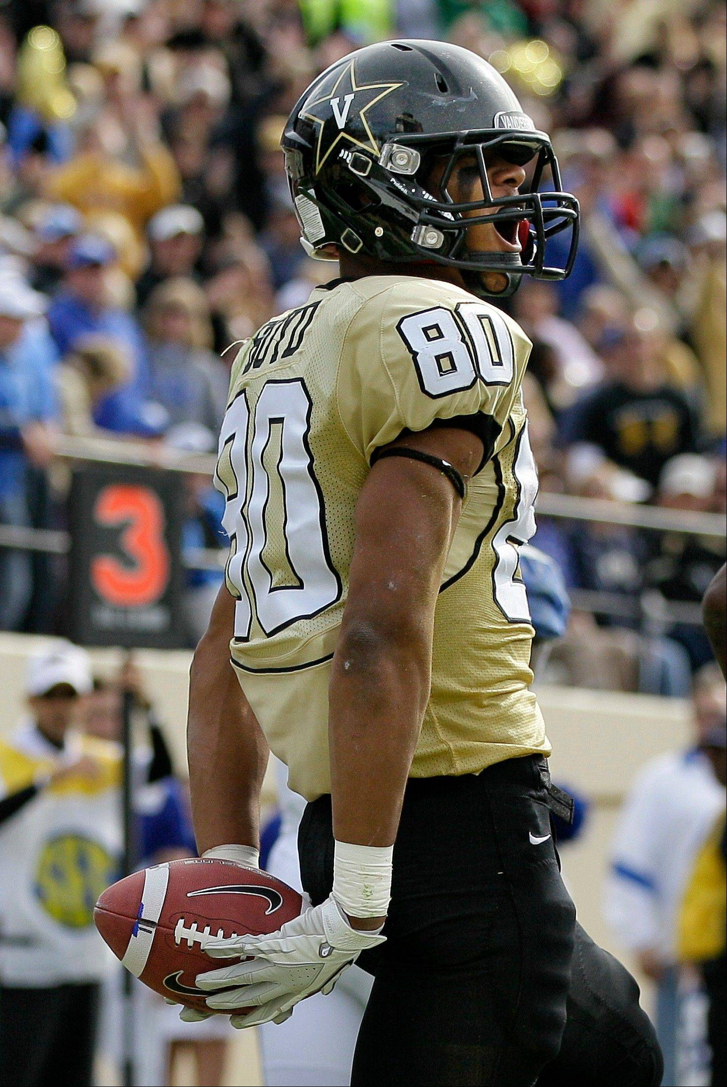 Associated Press Vanderbilt wide receiver Chris Boyd celebrates after scoring a touchdown against Kentucky during an NCAA college football game in Nashville. Metro Nashville Police said 21-year-old Boyd gave another defendant advice on how to cover up an alleged rape of an unconscious student on campus. Vanderbilt released a statement Friday, Aug. 16, saying he had been suspended from the team pending further review. Four other players already have been dismissed.