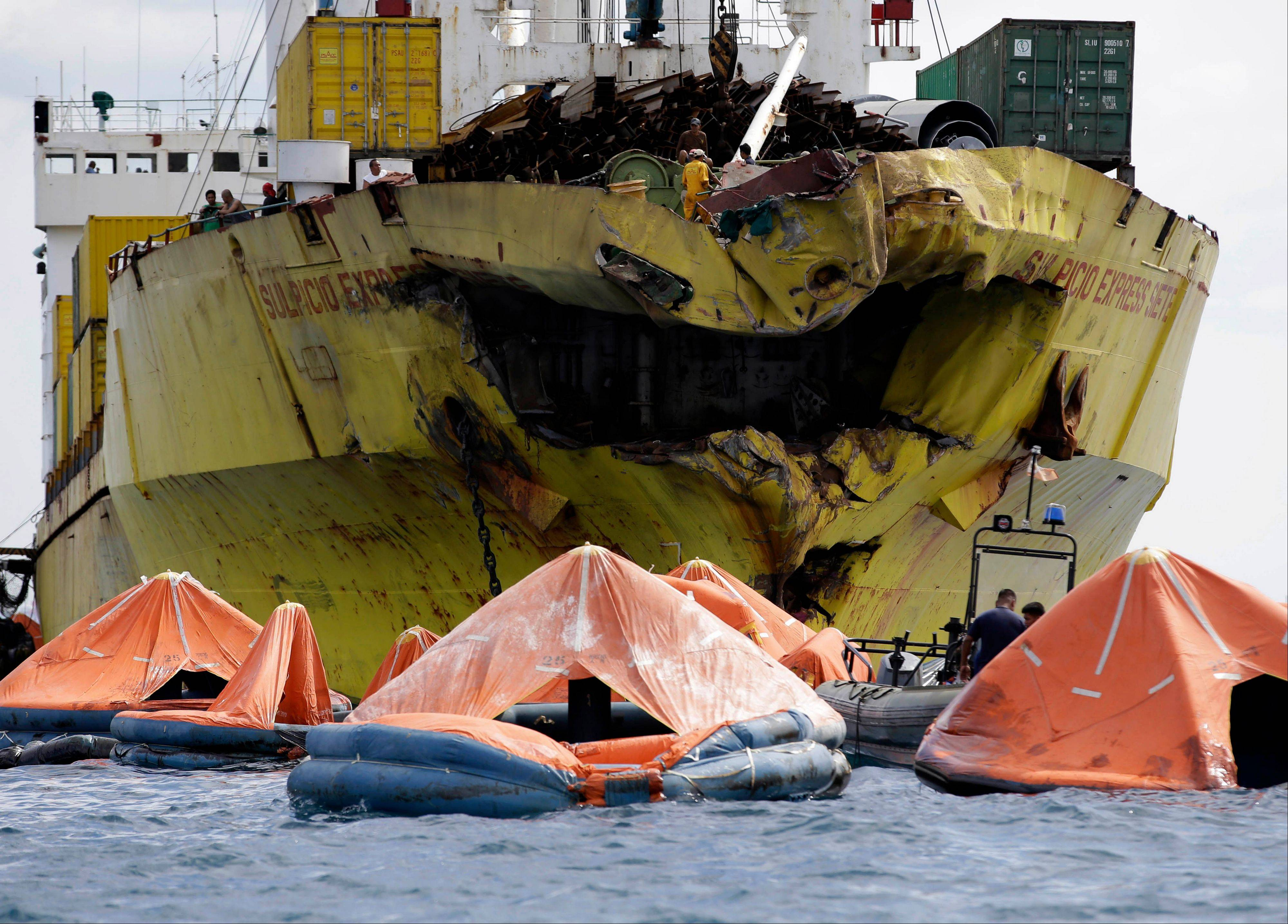 Associated Press A cluster of life rafts floats near the cargo ship Sulpicio Express Siete Saturday Aug. 17, a day after it collided with a passenger ferry off the waters of Talisay city, Cebu province in central Philippines. Divers combed through a sunken ferry Saturday to retrieve the bodies of more than 200 people still missing from an overnight collision with a cargo vessel near the central Philippine port of Cebu that sent passengers jumping into the ocean and leaving many others trapped. At least 28 were confirmed dead and hundreds rescued. The captain of the ferry MV Thomas Aquinas, which was approaching the port late Friday, ordered the ship abandoned when it began listing and then sank just minutes after collision with the MV Sulpicio Express, coast guard deputy chief Rear Adm. Luis Tuason said.