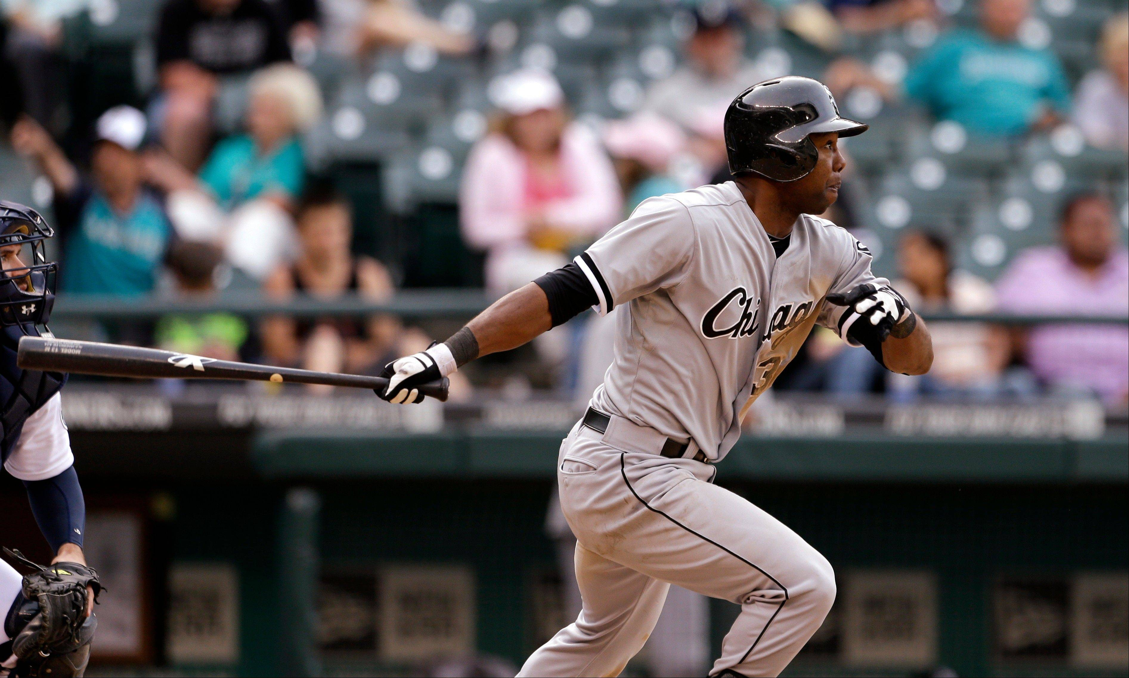 Chicago White Sox�s Alejandro De Aza drives in a run against the Seattle Mariners in the 16th inning of a baseball game on Wednesday, June 5, 2013, in Seattle. (AP Photo/Elaine Thompson)