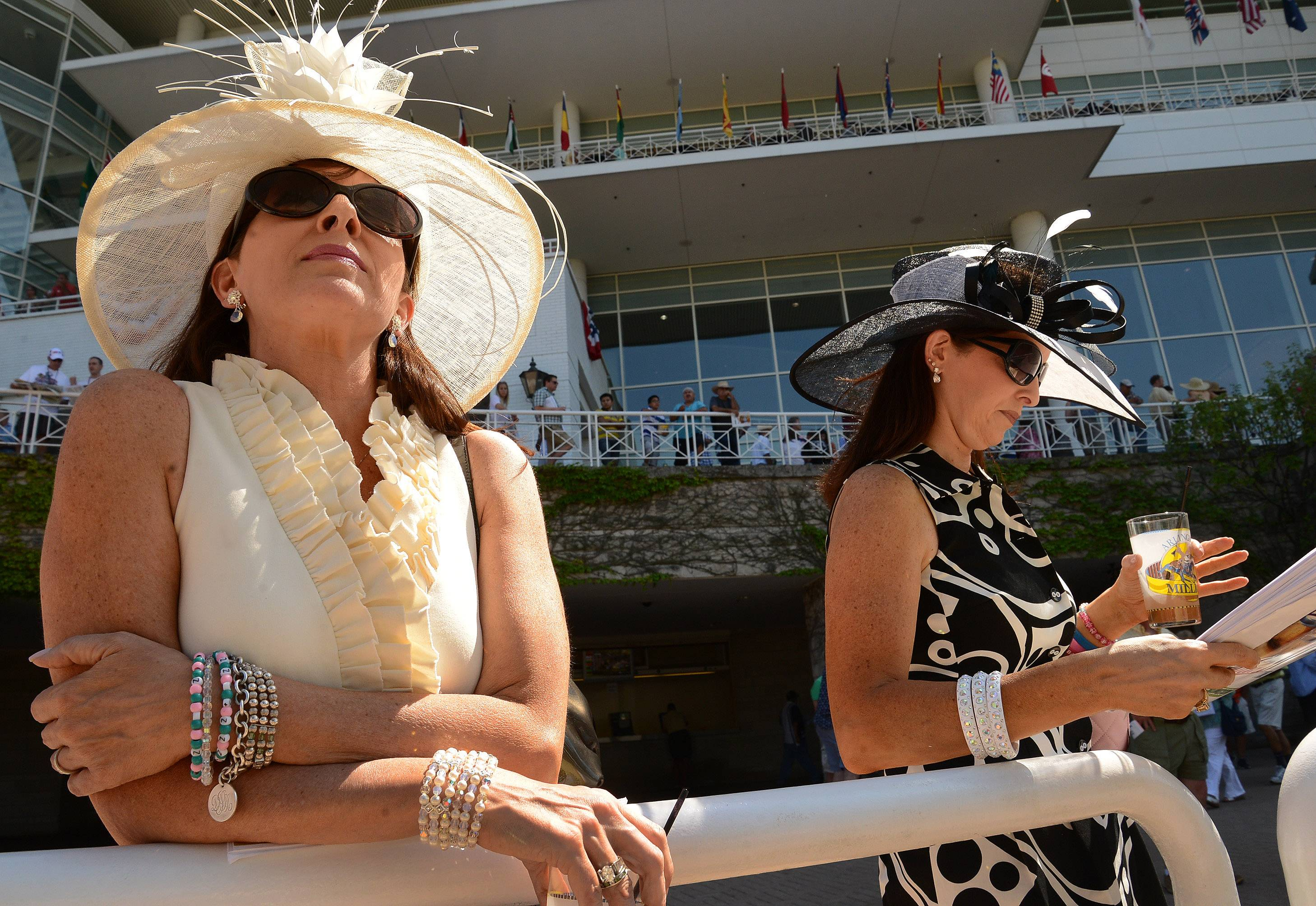 Donna Ludvik, left, and Dora Petruli,s both of Glendale Heights, watch for their favorite horses in the paddock during the Arlington International Festival of Racing at Arlington Racecourse.