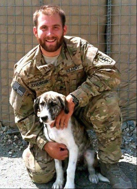 Army Sgt. Tim Johannsen and his battle buddy, Leonidas, in Afghanistan in 2011. The Puppy Rescue Mission helped bring Leonidas home to live in Downers Grove with Johannsen's wife, Kaydee, and her family while he finished his combat tour. They were reunited in 2012 and now live in Hawaii.