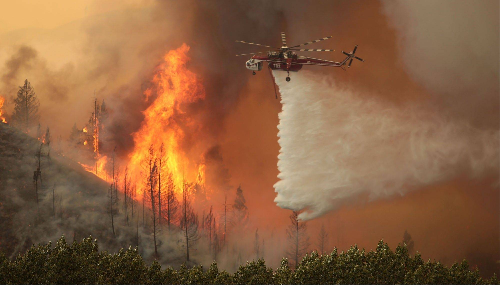 Helicopters battle the 64,000 acre Beaver Creek Fire on Friday.