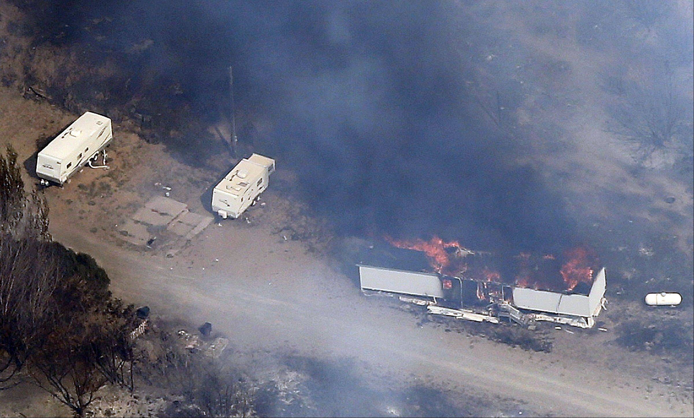 The Patch Springs Fire burns a trailer in the Stansbury Mountains of Utah, Friday.