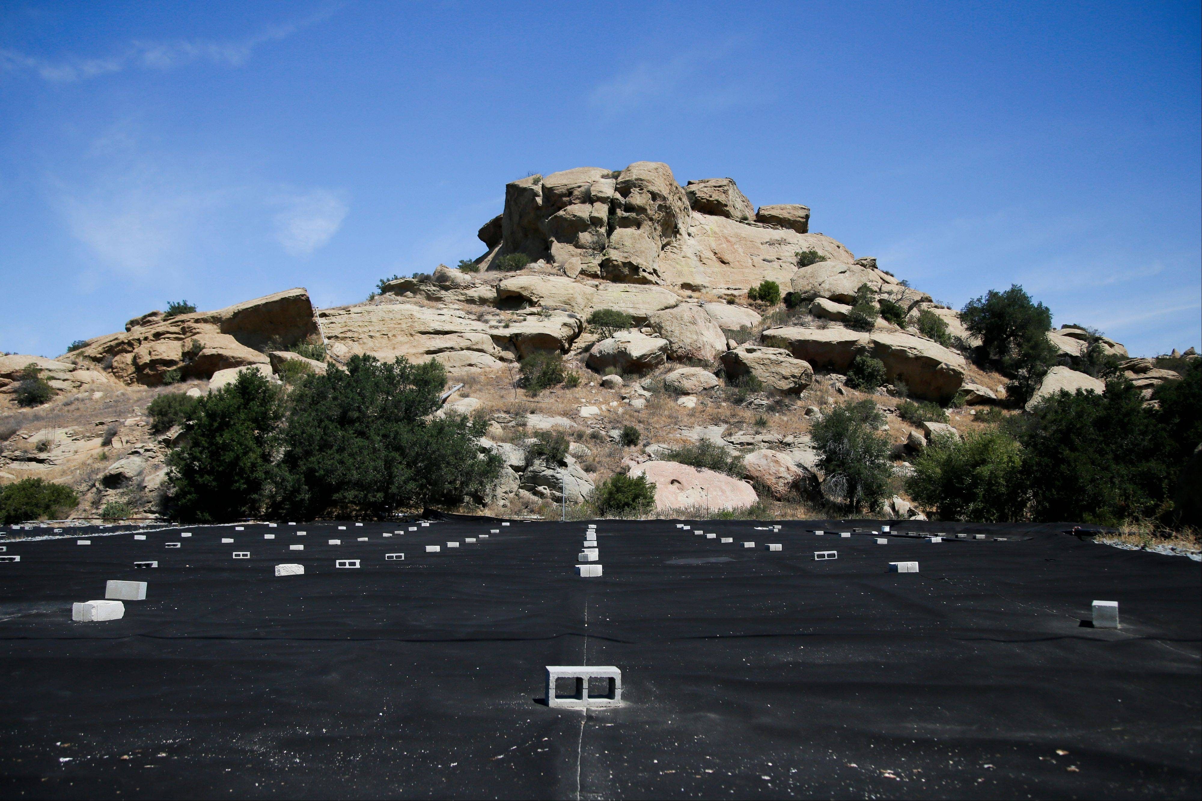 A black tarp covers the field to stabilize mercury-containing soil at the Santa Susana Field Laboratory in Simi Valley, Calif. last July. Founded in 1947 by North American Aviation, Santa Susana quickly became an aerospace hub.