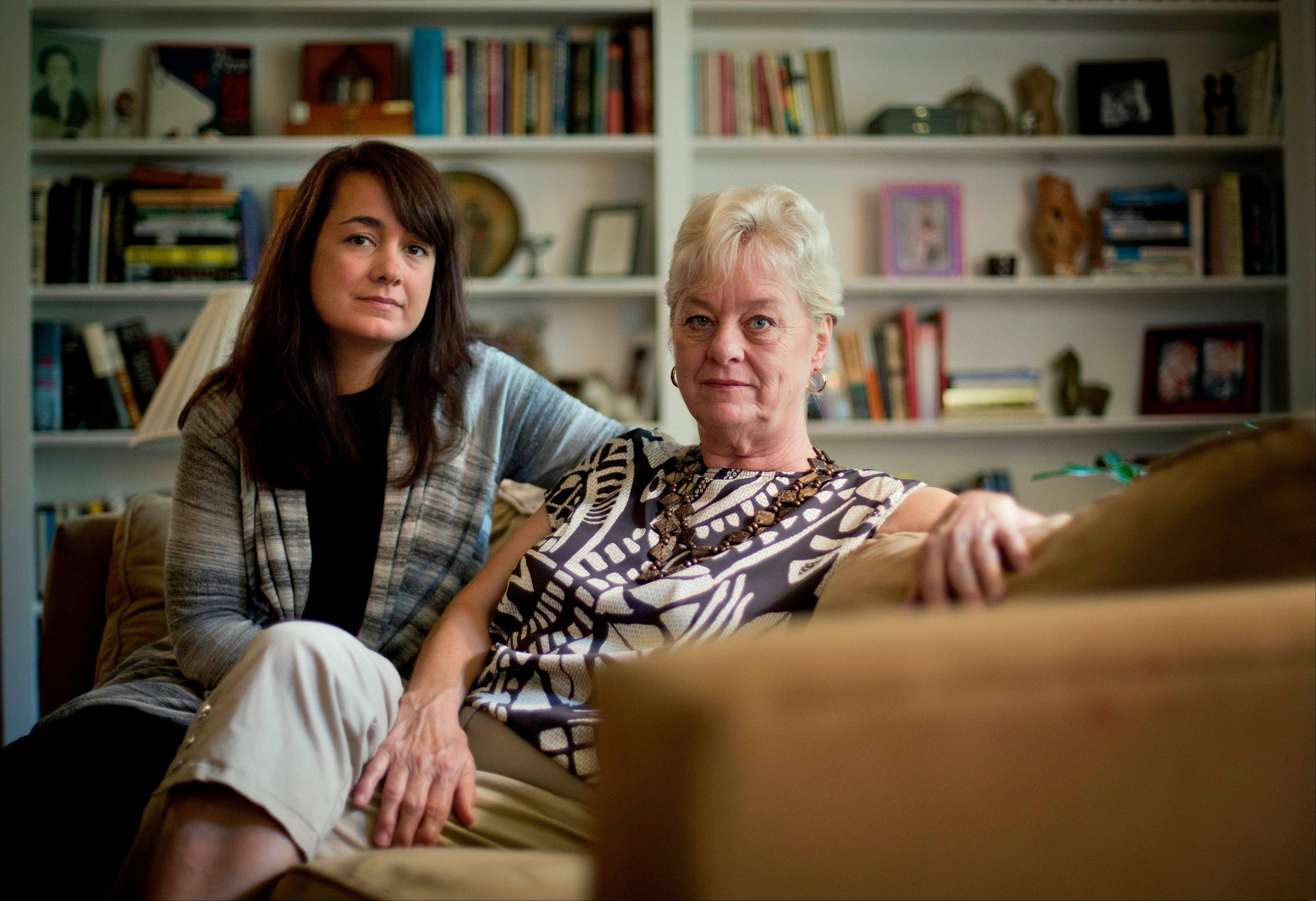 "Associated PressKeely Walker Muse, left, sits with her mother Eve Walker in the living room of her home in Atlanta, Saturday, Aug. 17. Mexican drug lord Rafael Caro Quintero was sentenced to 40 years in prison for the 1985 murders of her father, journalist John Clay Walker, his friend Alberto Radelat, and DEA agent Enrique ""Kiki"" Camarena, among other crimes. According to witnesses interviewed by DEA agents hunting for Camarena's killers, the cartel had mistaken Walker and Radelat for undercover agents. Caro Quintero walked free this month, 12 years early, after a local appeals court overturned his sentence for three of the murders. For the families of the six Americans slain before Camarena, the decision has awakened bitter memories of the brutality that ushered in the modern era of Mexican drug trafficking."