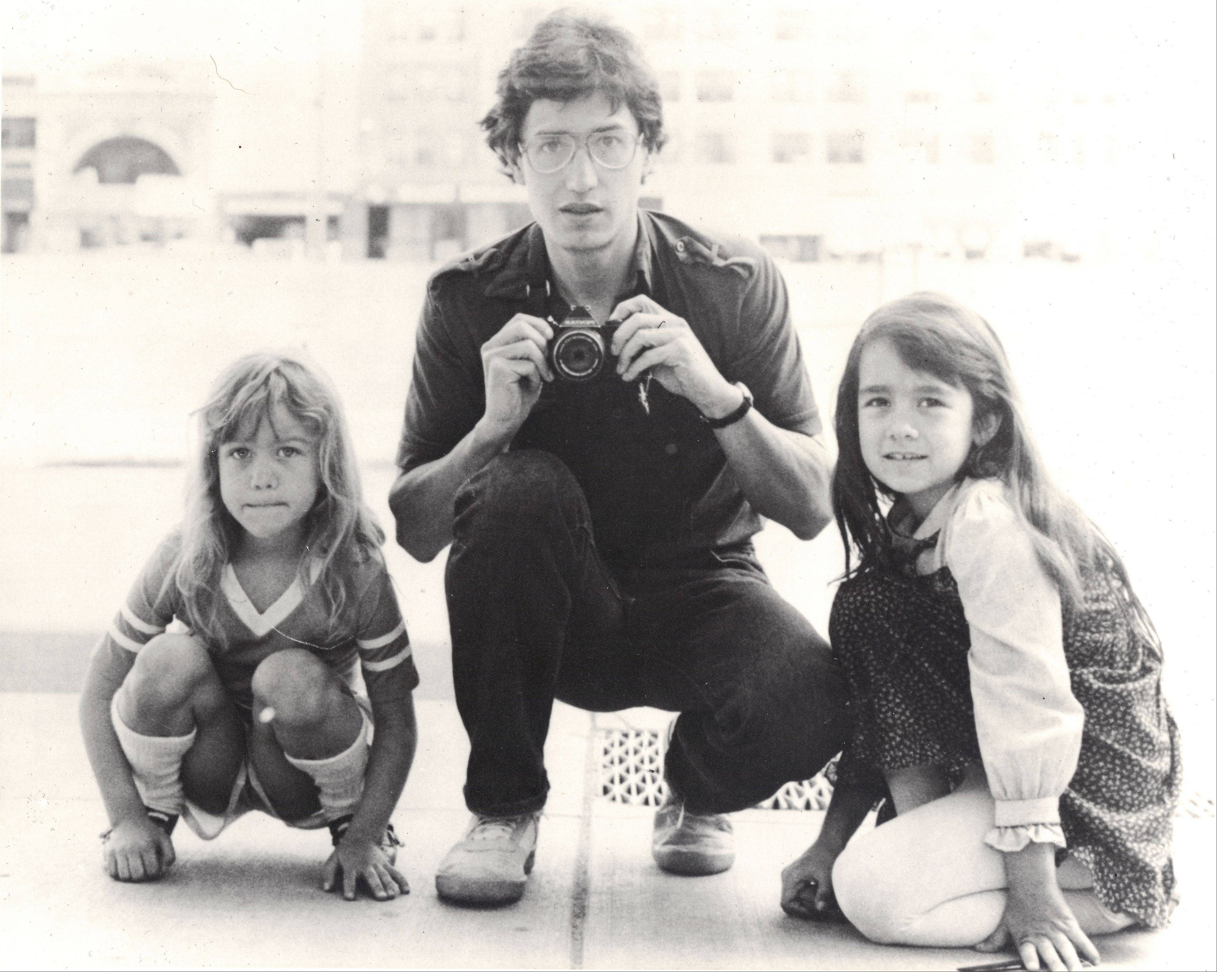 "Associated PressIn this undated photo provided by Keely Walker Muse, her father journalist John Clay Walker poses for a portrait with his daughters Lannie, left, and Keely in Minneapolis. Mexican drug lord Rafael Caro Quintero was sentenced to 40 years in prison for the 1985 murders of Walker, his friend Alberto Radelat, and DEA agent Enrique ""Kiki"" Camarena, among other crimes. According to witnesses interviewed by DEA agents hunting for Camarena's killers, the cartel had mistaken Walker and Radelat for undercover agents. Caro Quintero walked free this month, 12 years early, after a local appeals court overturned his sentence for three of the murders. Walker was a Marine who was twice wounded by land mines in Vietnam and then worked as a newspaper journalist before taking his family to Mexico so he could write his book in a place where his pension could stretch further. He and his wife were befriended by Radelat, a dentist looking at taking classes at the main university in Guadalajara."