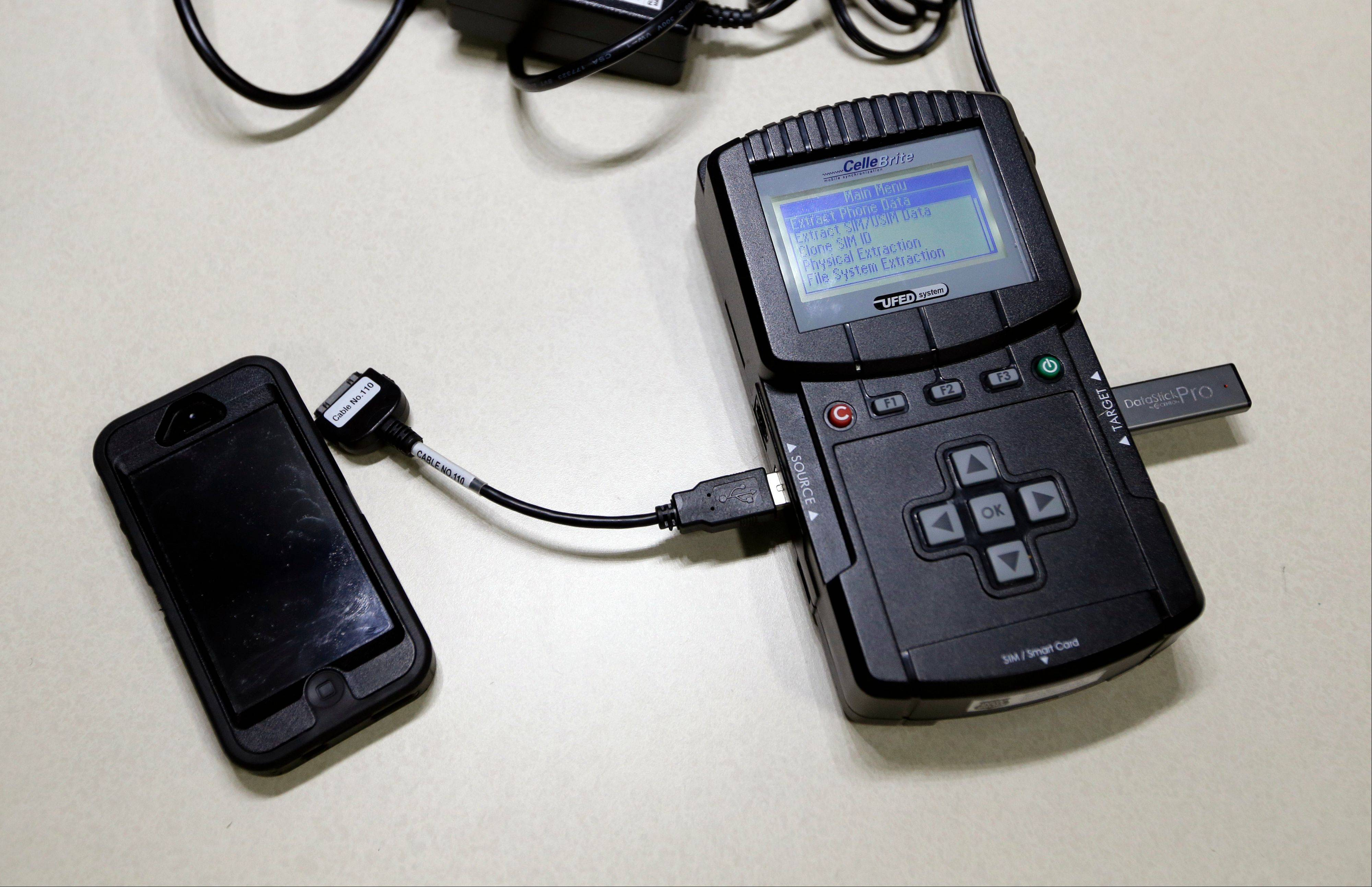 This Feb. 19, photo shows a Universal Forensic Extraction Device used by the Indiana State Police, in Indianapolis. The device is used for data extraction, transfer and analysis for cellular phones and mobile devices by an Indiana task force that is building a national reputation for aggressive pursuit of child pornographers worldwide.