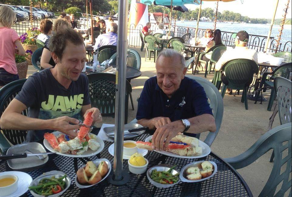 "Ed Wolowiec, right, owner of Port Edward in Algonquin, dines with Elliott Bambrough, host of ""Chicago's Best."" Port Edward will be featured on the show Sunday for its Alaskan King crab legs and unique back story."