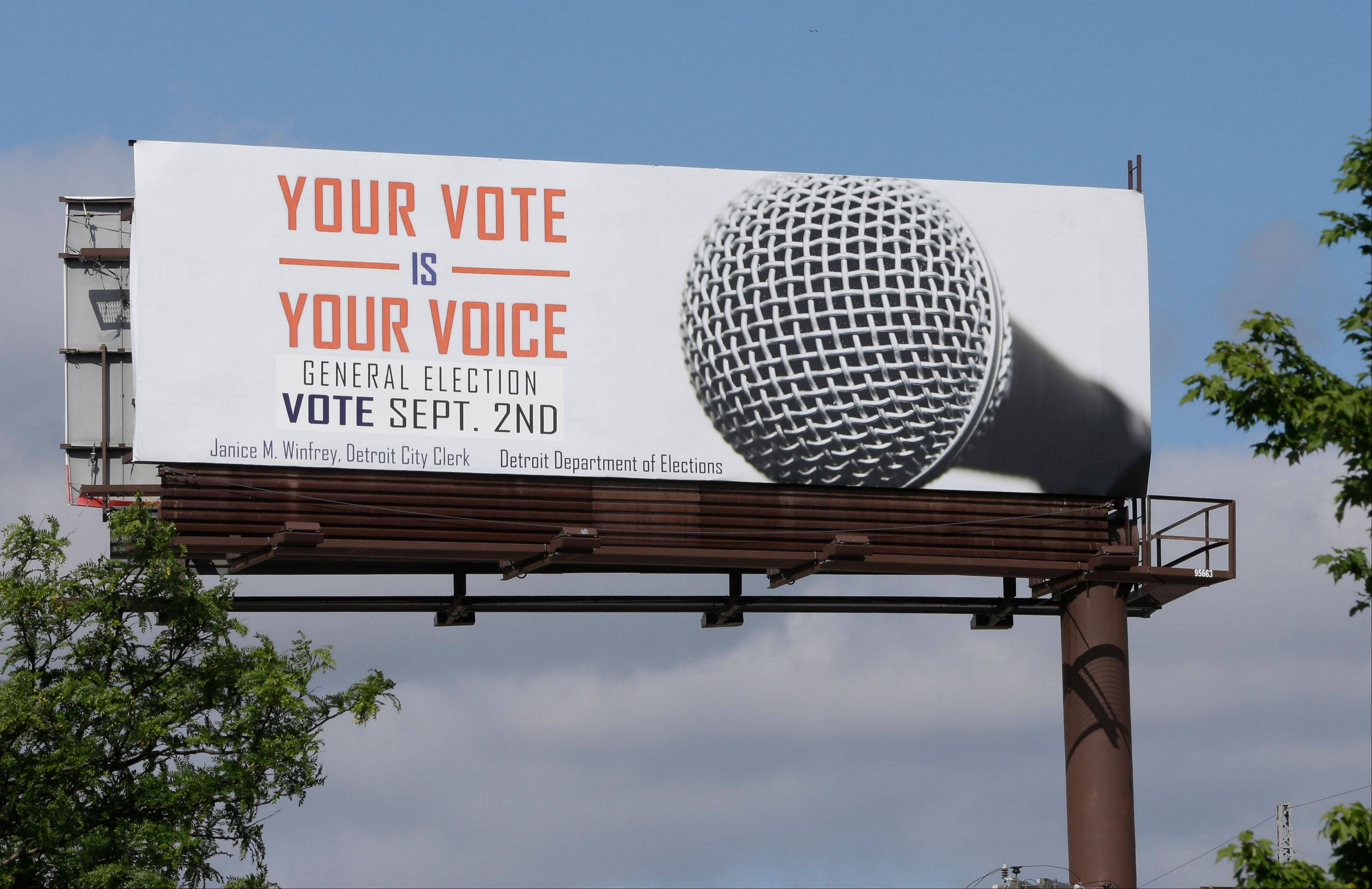 "One of the billboards seen on Tuesday, Aug. 13, 2013, promoting Detroit's upcoming general election offered up some erroneous information about when to go to the polls. The Detroit Free Press reports that many of the 14 billboards gave a September date for the election. The vote will actually take place Nov. 5. City Clerk Janice Winfrey says the billboards were updated Saturday with information about the general election, and she calls the September date ""a mistake"" by the business that handles the billboards."