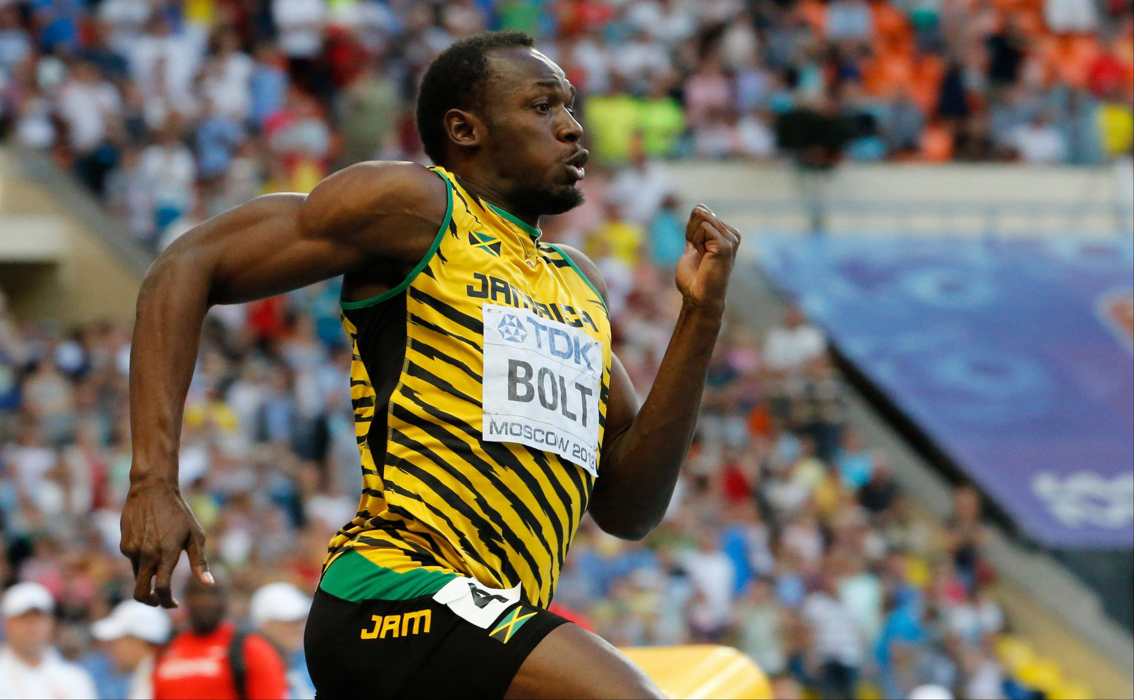 Jamaica's Usain Bolt competes in the men's 200-meter final at the World Athletics Championships in the Luzhniki stadium in Moscow, Russia, Saturday, Aug. 17, 2013.