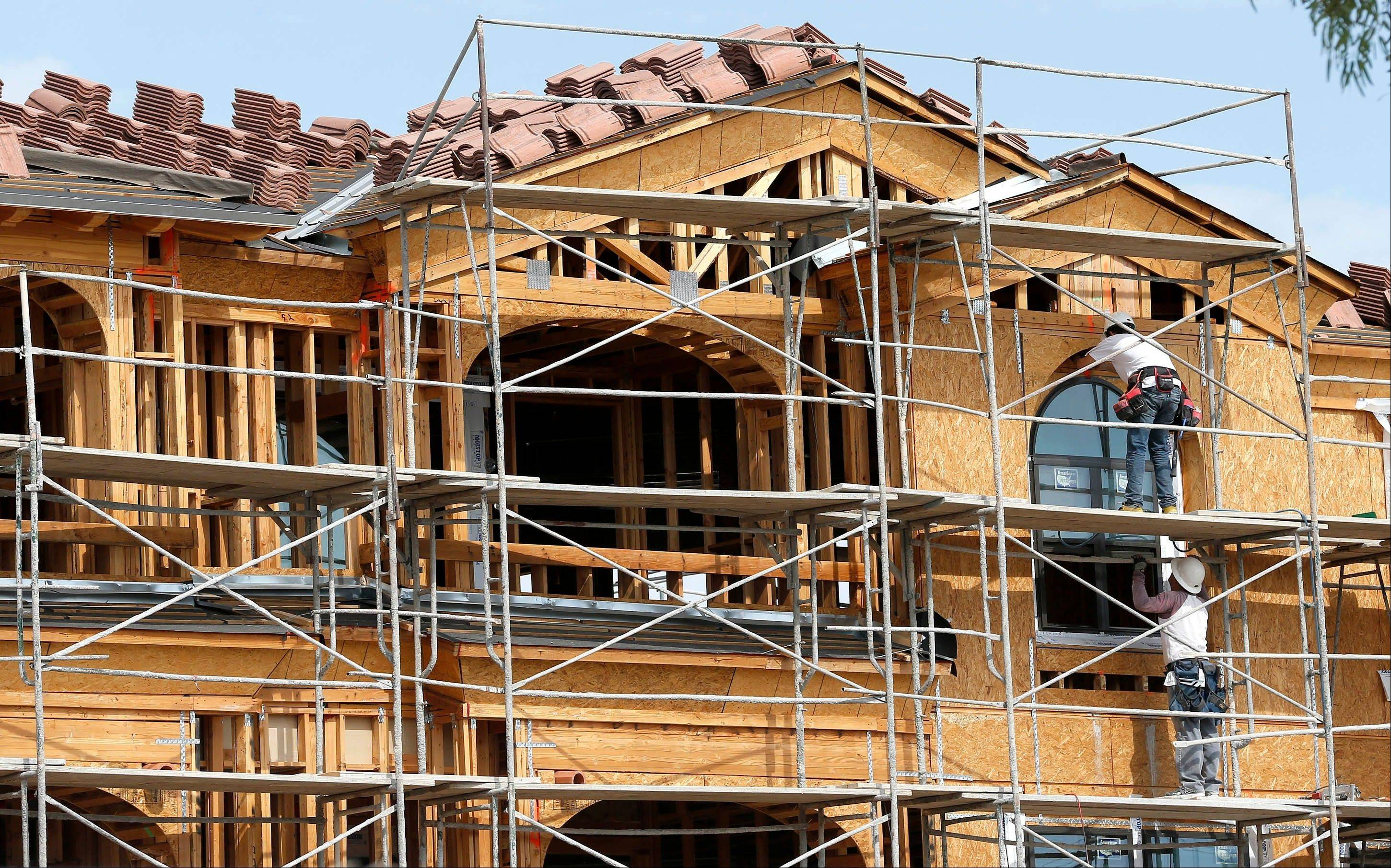 Construction workers install exterior windows on an apartment complex in Tempe, Ariz. Spending on home remodeling has picked up over the past 18 months and is expected to rise nearly 20 percent to $151 billion by the fourth quarter of 2013, according to a recent report by the Joint Center for Housing Studies at Harvard University.