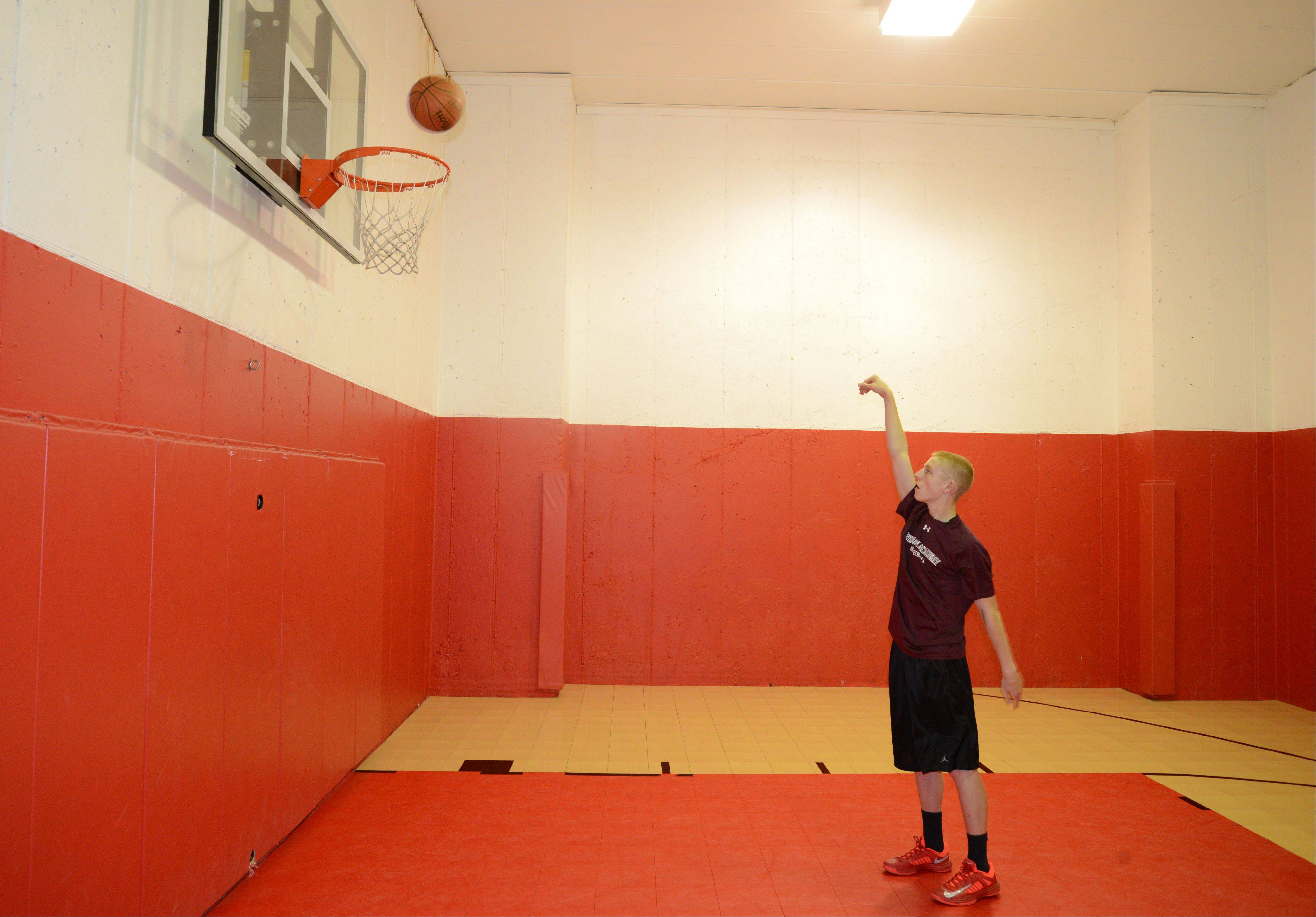 Three-point shooting Phenom Josh Ruggles takes a shot Friday at his home basketball court in Wheaton. The Wheaton Academy junior is building a YouTube fan base with a video showing him making 135 three-point baskets in 5 minutes.