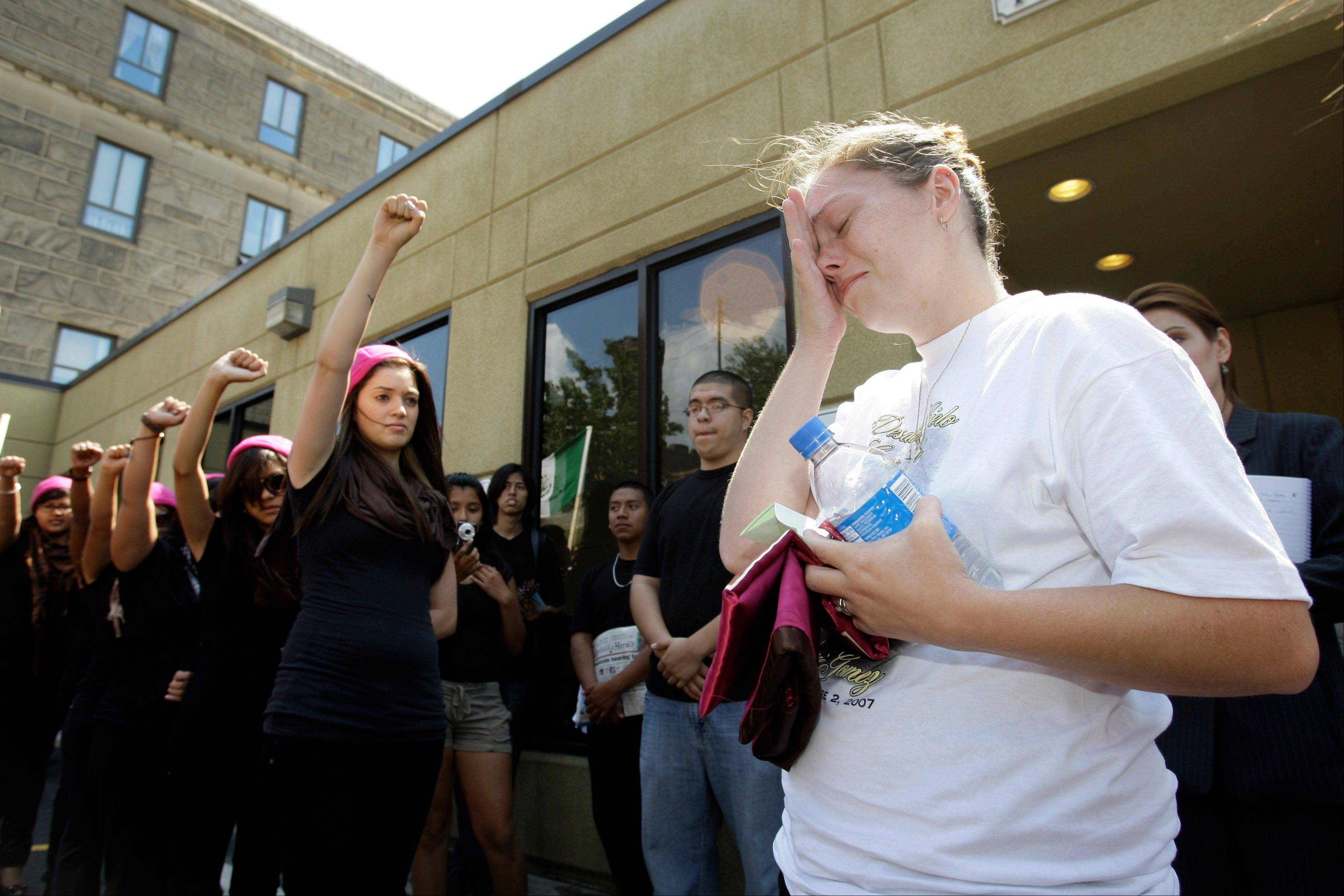 Crystal Dillman is moved to tears as members of Latina show their support, as she leaves a courthouse in Pottsville, Pa., on Aug. 18, 2008, following preliminary hearings for three suspects, charged in the beating death of her fiance Luis Ramirez, a 25-year-old Mexican immigrant.
