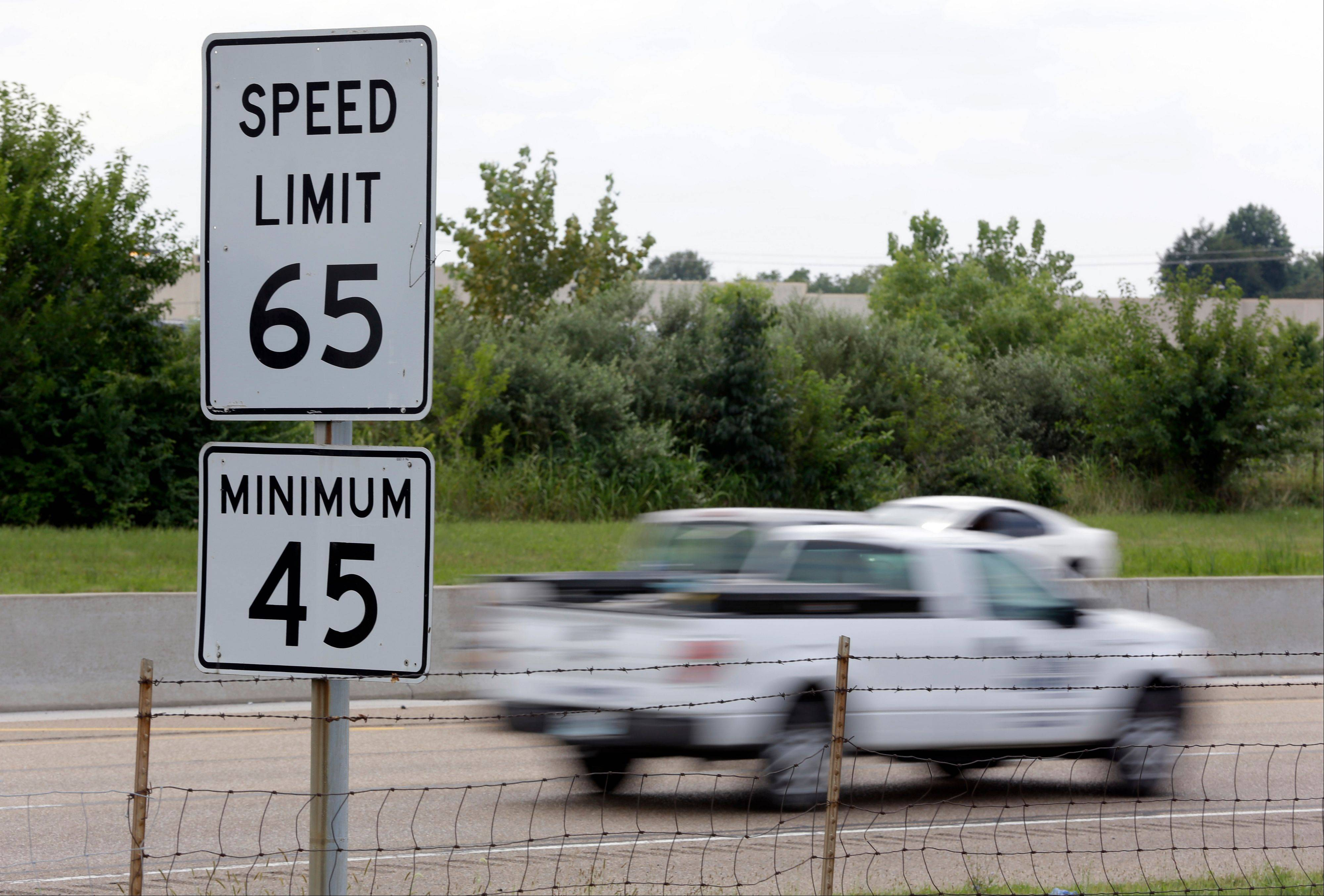 ASSOCIATED PRESS Vehicles pass a speed limit sign along Interstate 64 in O'Fallon, Ill. Gov. Pat Quinn has until Monday to sign or veto legislation that would raise the speed limit on rural interstates in Illinois from 65 mph to 70 mph starting in January.