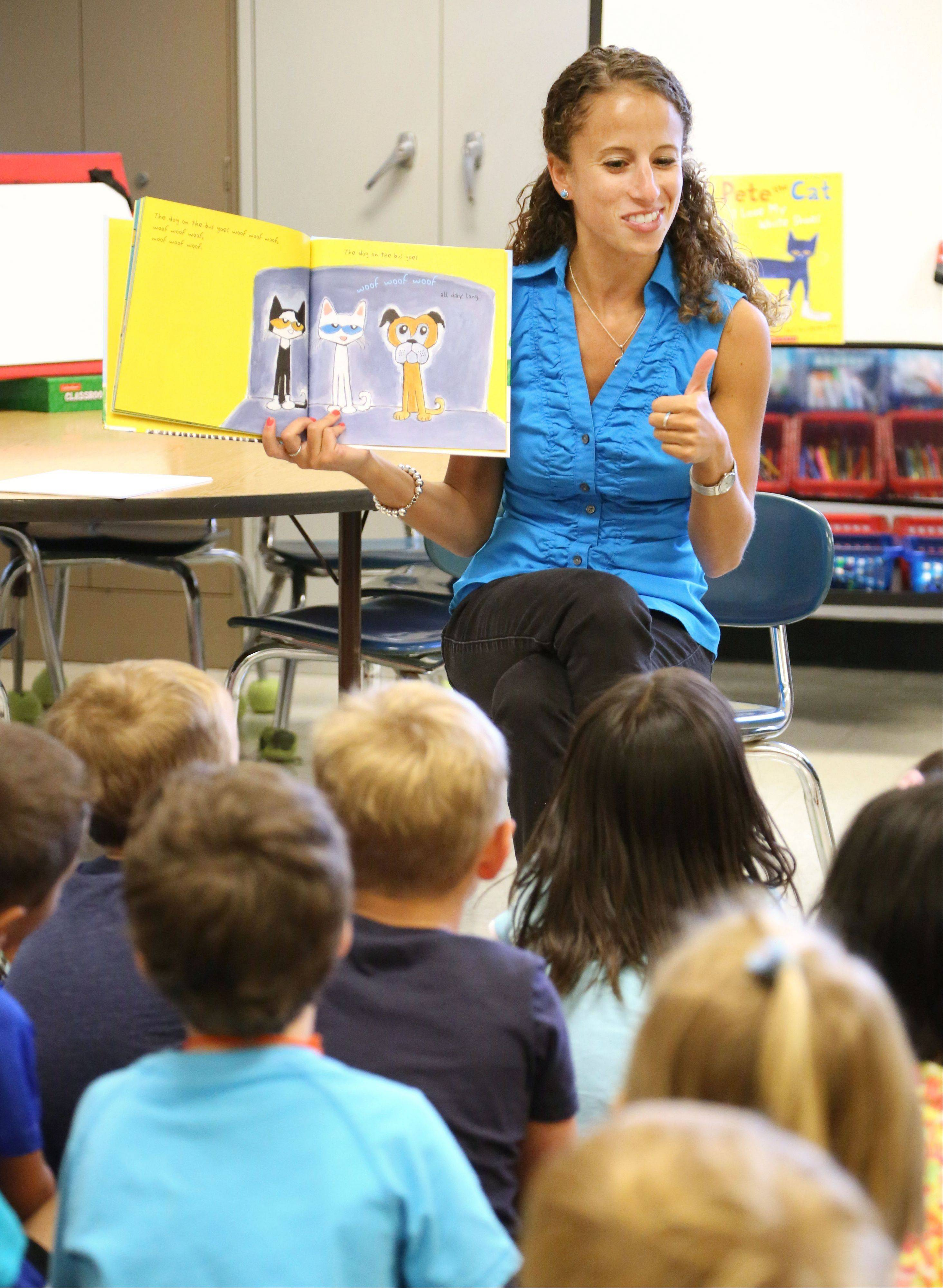 Kindergarten teacher Julie Silverberg reads to her students during class at Washington Elementary School in Mundelein. The lesson ties into the new Common Core State Standards by teaching kids how to ask and answer questions about books.